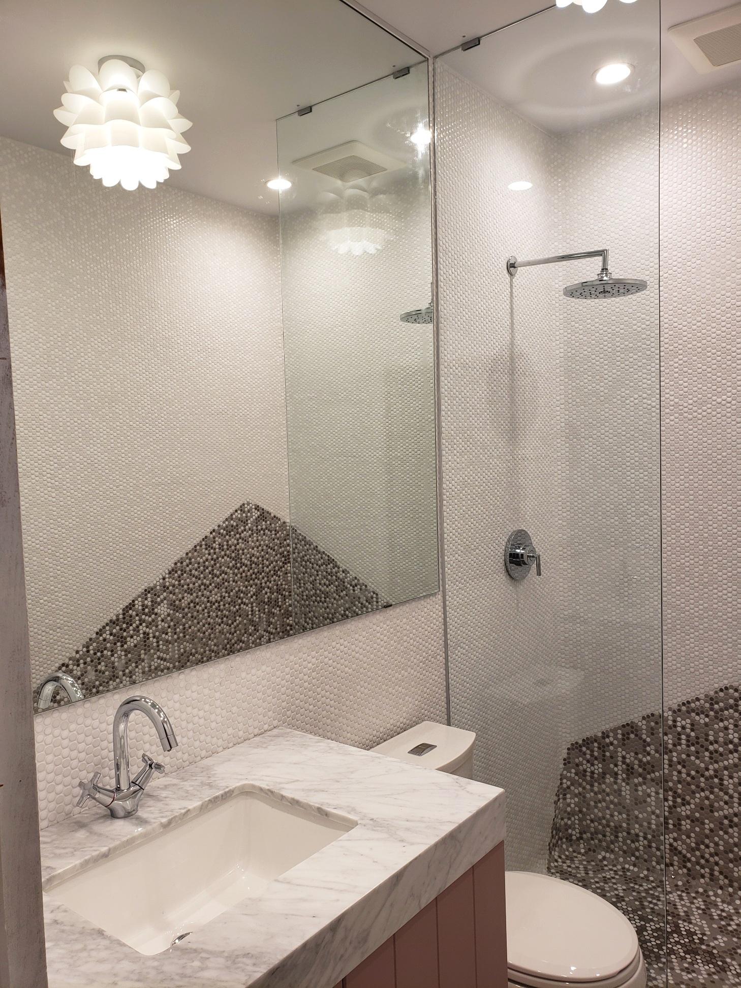 colorful glam pink grey penny tile bathroom mirror