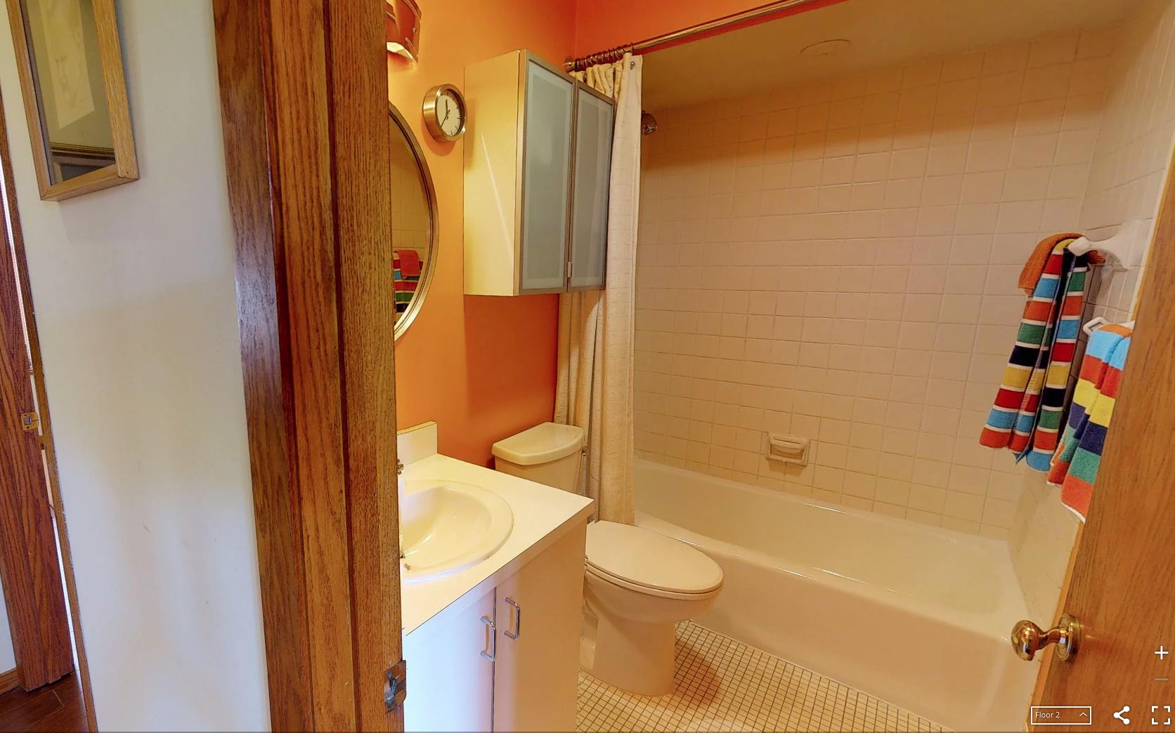 Before orange bathroom remodel