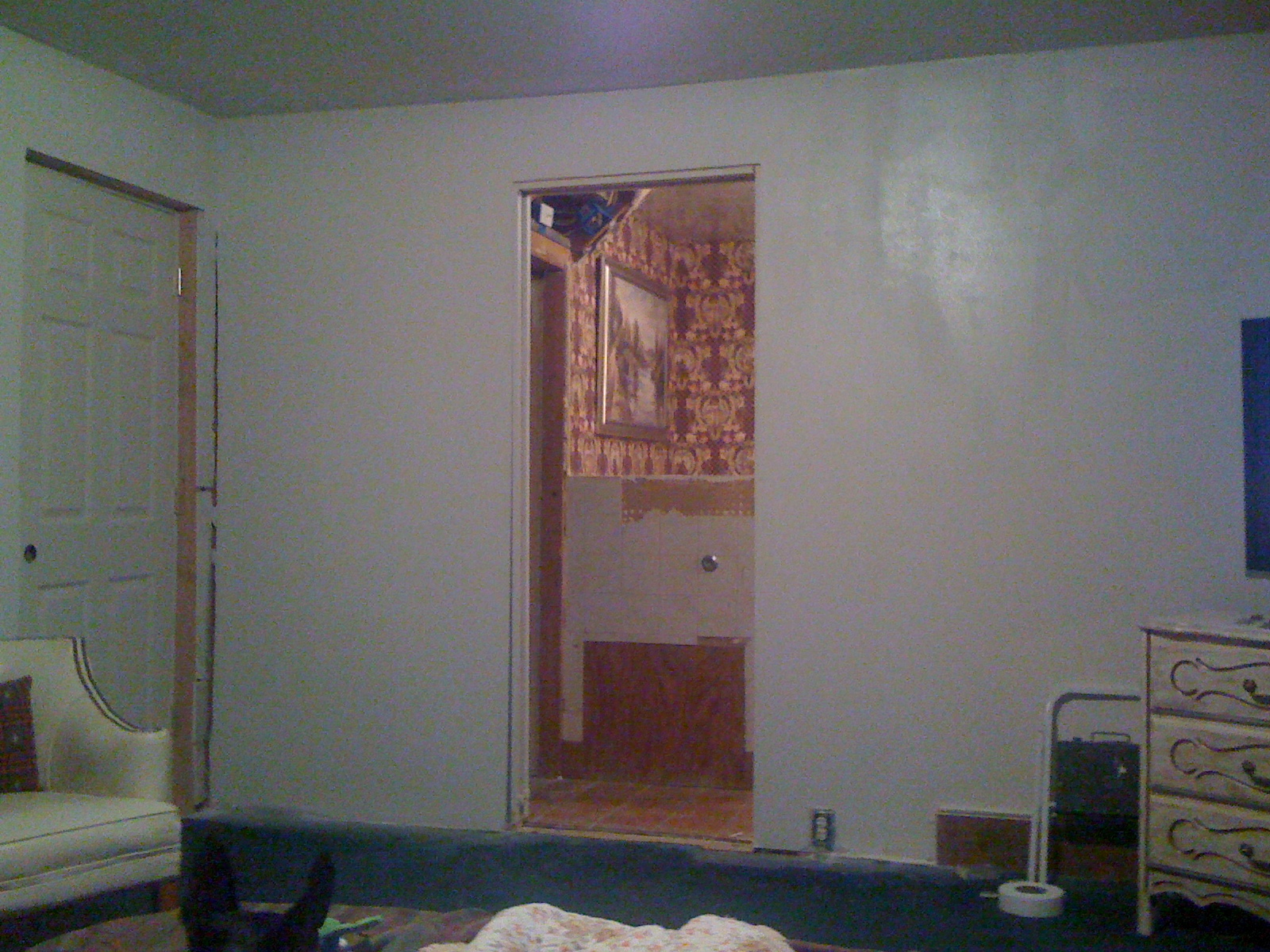 New pocket door entrance to master bath. This wall used to be closed off. New bedroom entry door to the left.