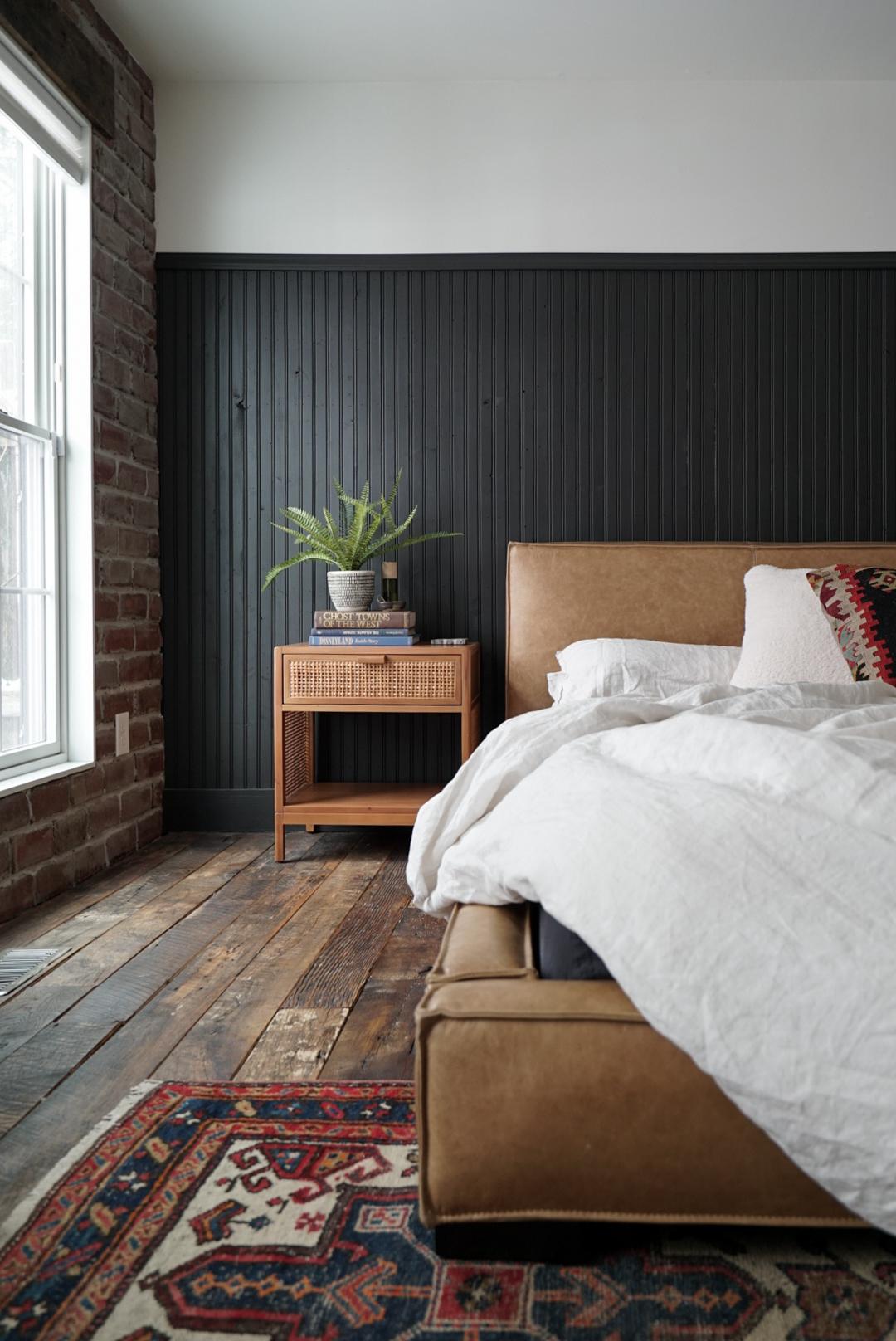 Nordic master bedroom black wainscoting