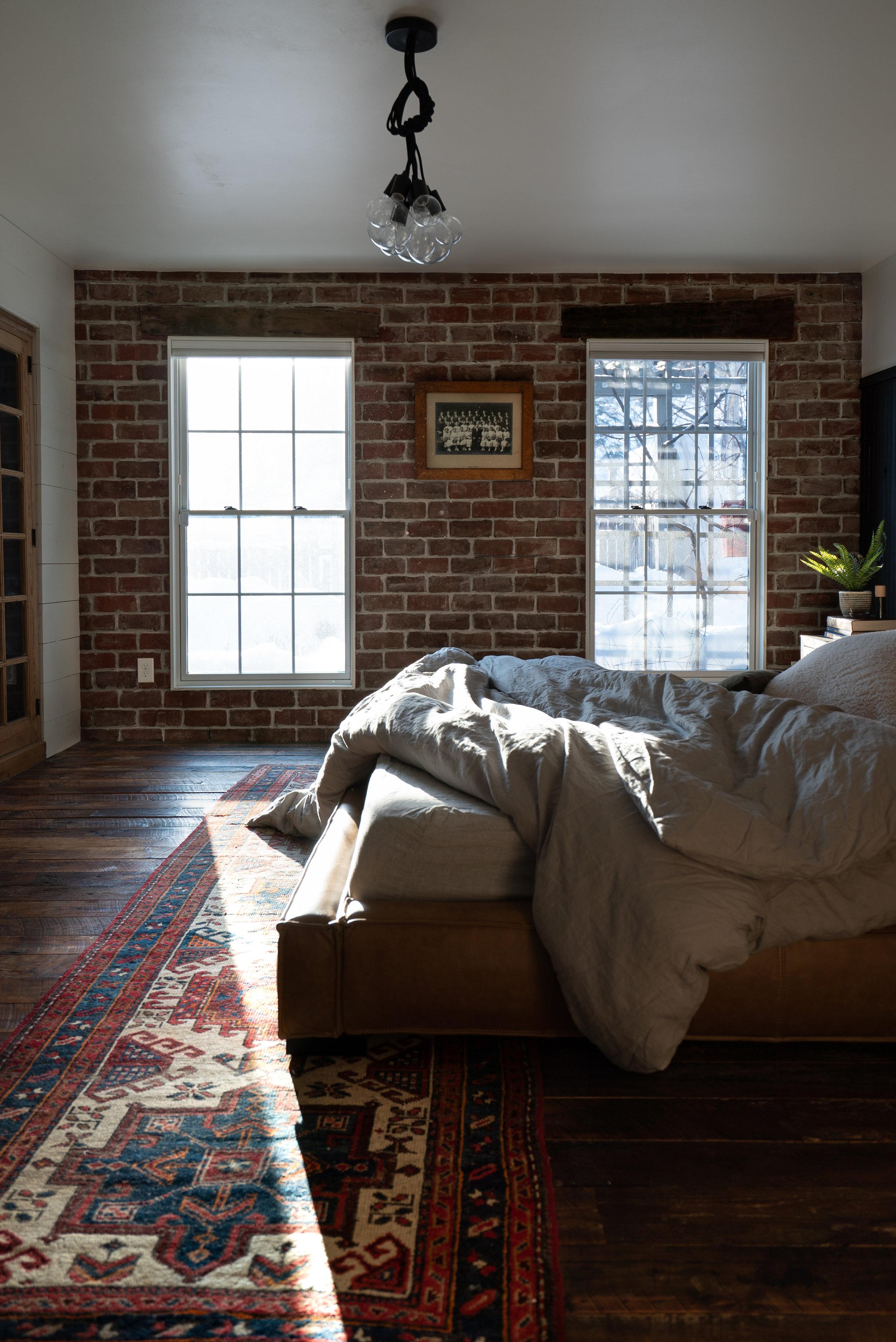 reclaimed street pavers master bedroom wall
