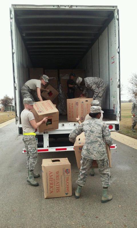 WAA unloading our truck.jpg