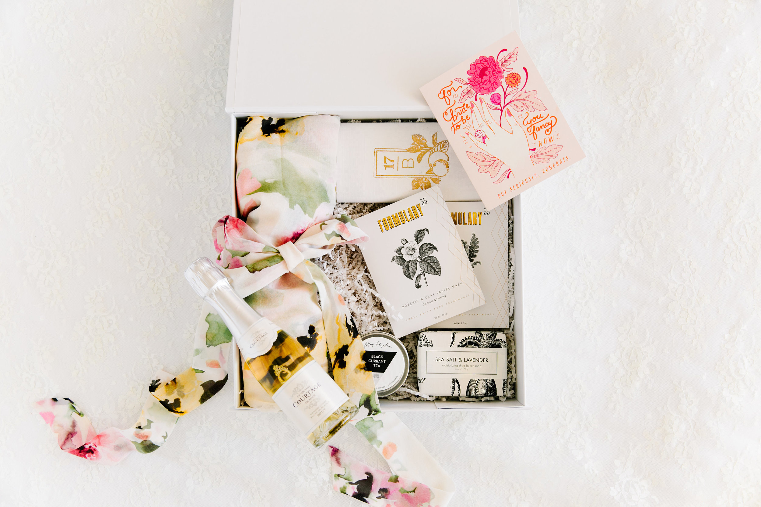 "Get your best gal wedding day ready with our   ""BEST DAY EVER""   happy!     This premium gift box includes a luxiourious bridal robe, a bubbly beverage, a card, chocolate bar, candle, + everything she needs for the honeymoon ... a bath bar, foot soak, + face mask."
