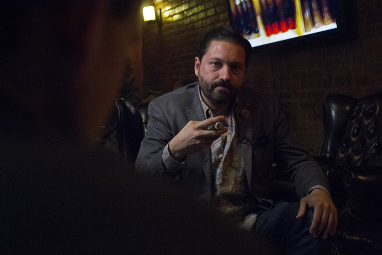 Wall Street Journal coverage of Principle Cigars' Slow-Smoking events in Harlem, New York City.