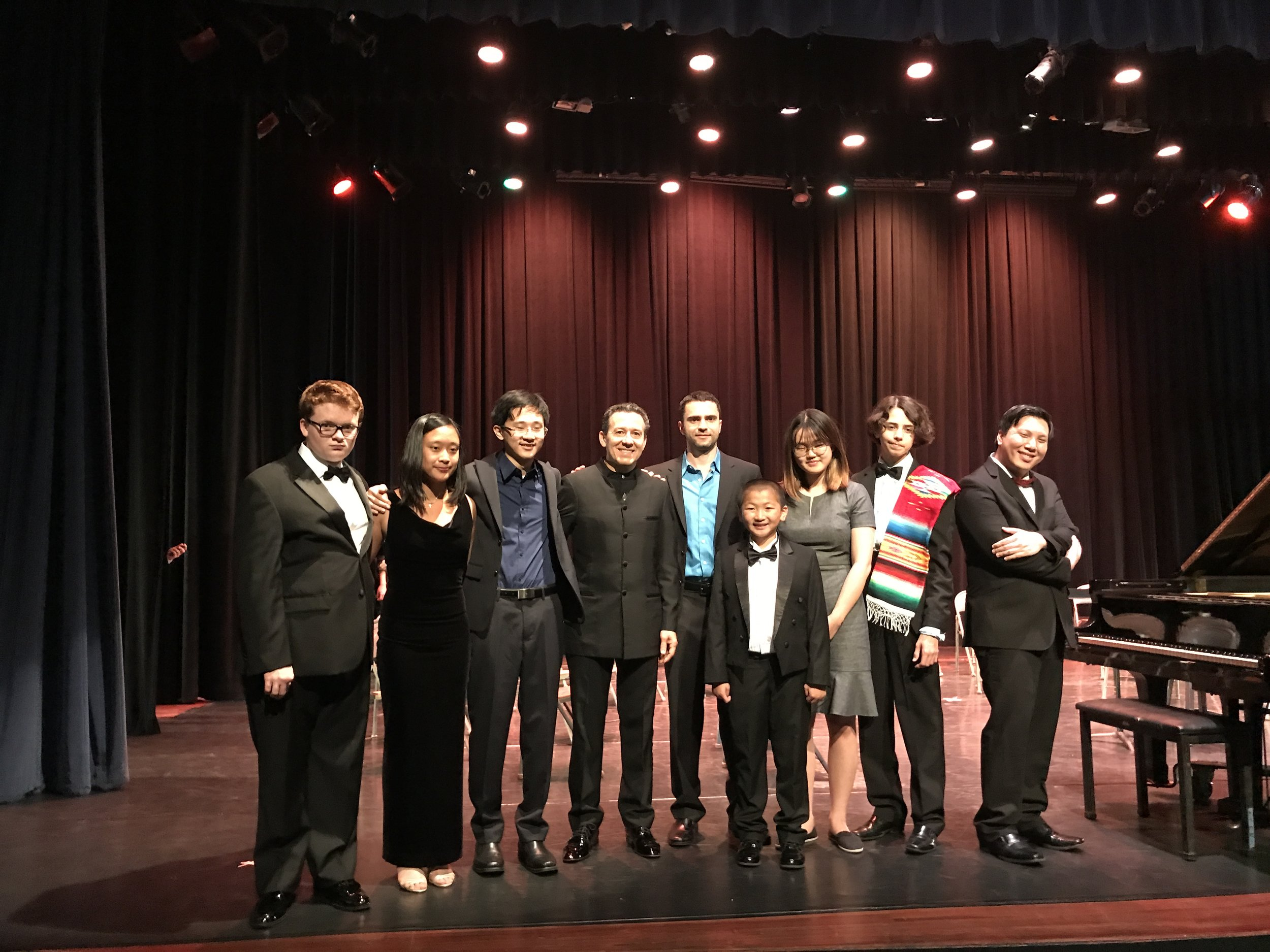 Performers with the conductor, Maestro Alejandro Gutierrez (fourth from left)
