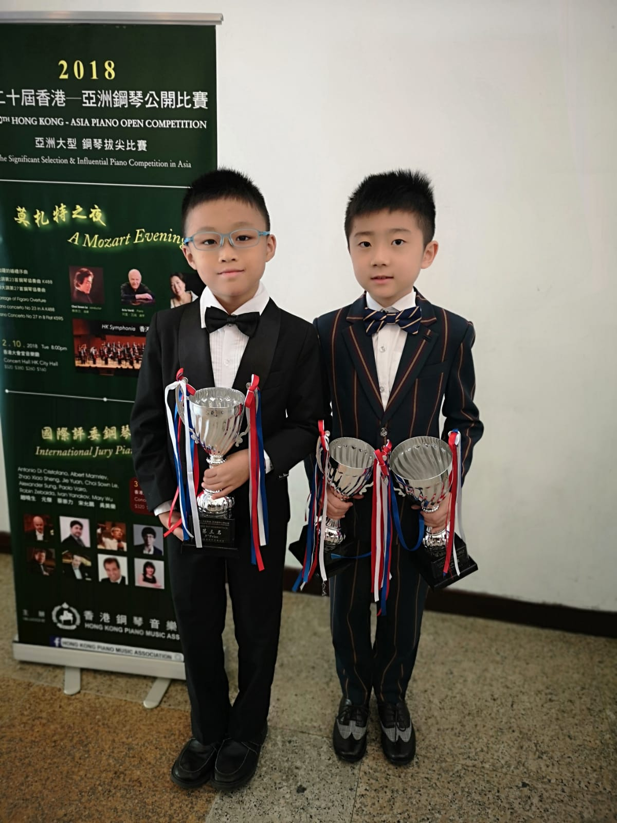 Nicholas Chin (left) and Cao Jun Wei (right) with their trophies.
