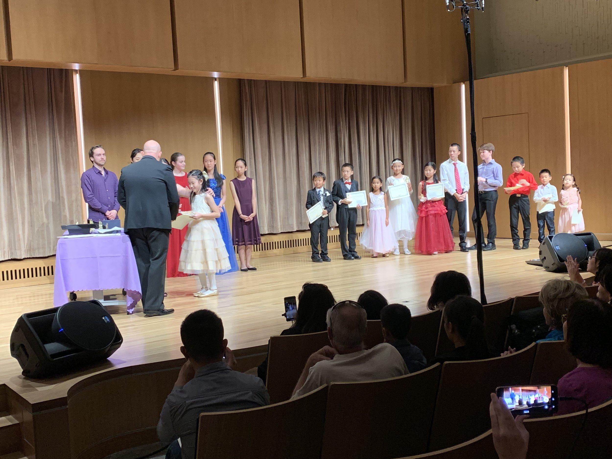 Casey Li receiving her awards