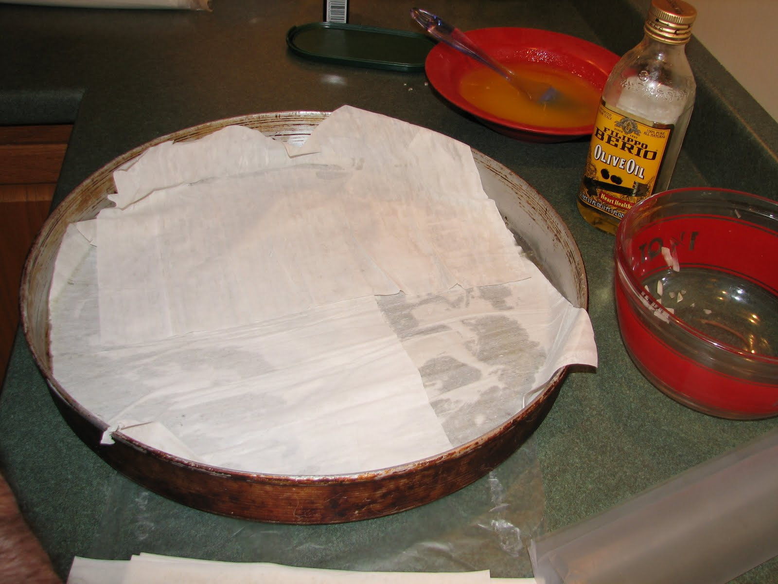 This is Bill's special pan for making a giant kotopita pie. You can buy one in the Immigrant Kitchens store [link to product page], or simply make more than one pie in smaller baking dishes that you already have. Use butter or olive oil to butter the pan before adding those first sheets of phyllo.