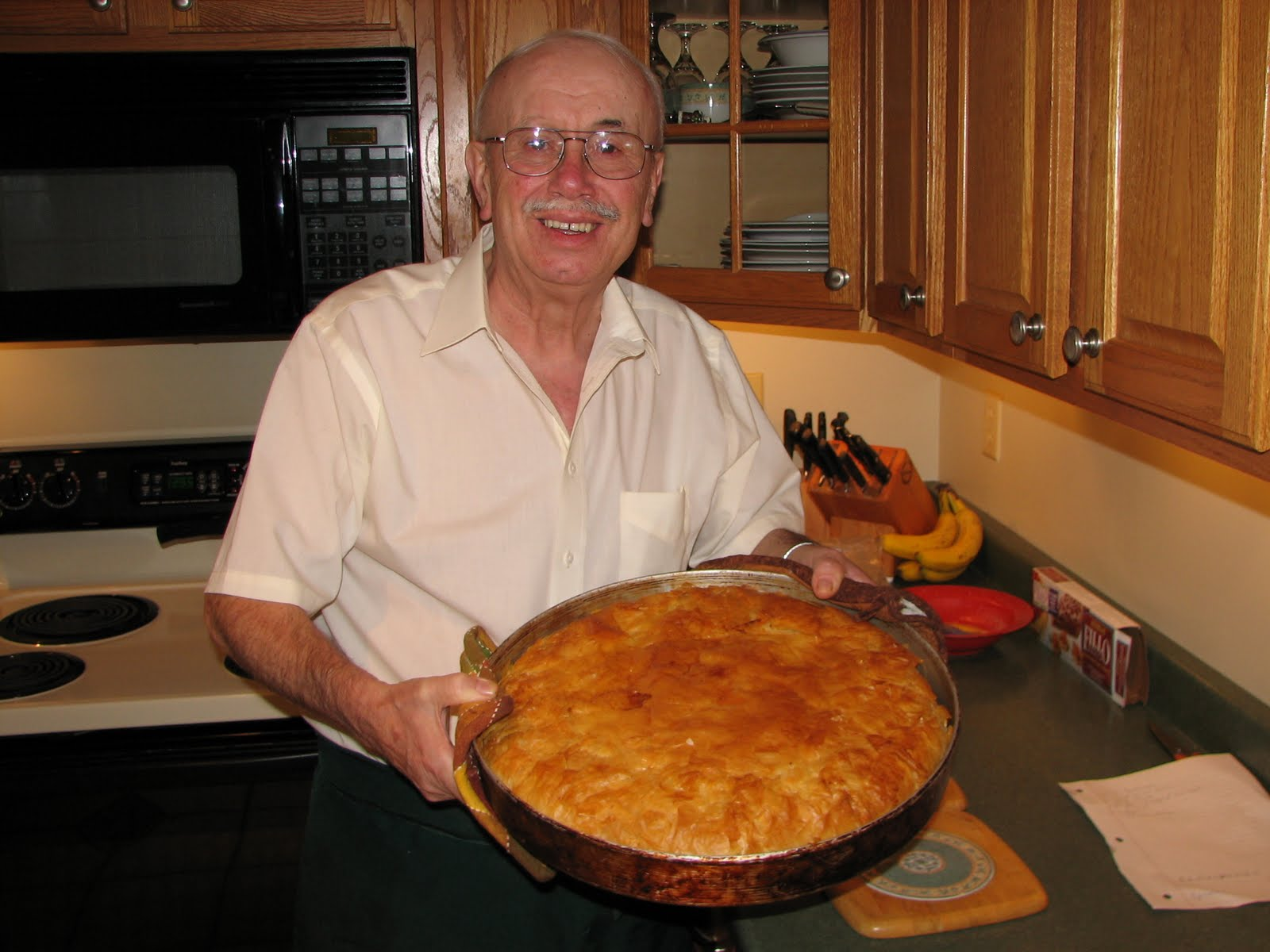 Bill Dilios, of Politsani, Albania, (formerly part of Greece) with his favorite food, a chicken and rice pie in phyllo dough.