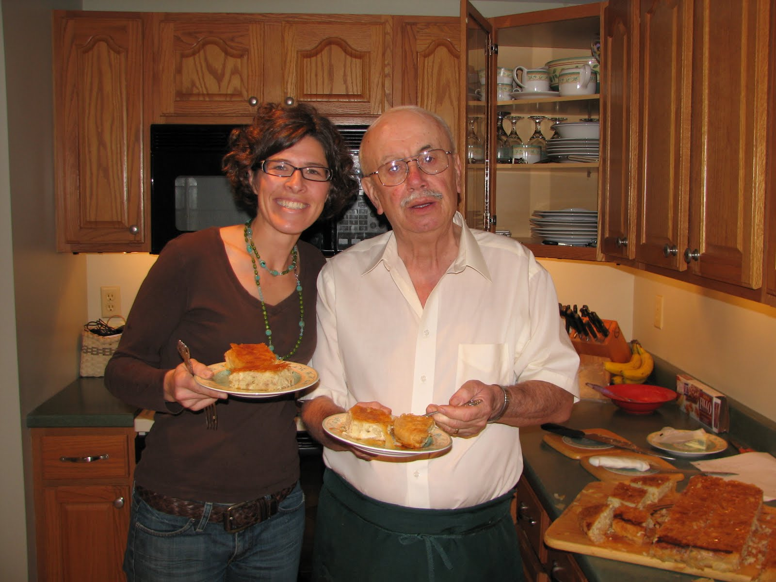 Bill Dilios (left) shares his favorite food from his childhood in Politsani, Albania, with chef Lindsay Sterling (right).
