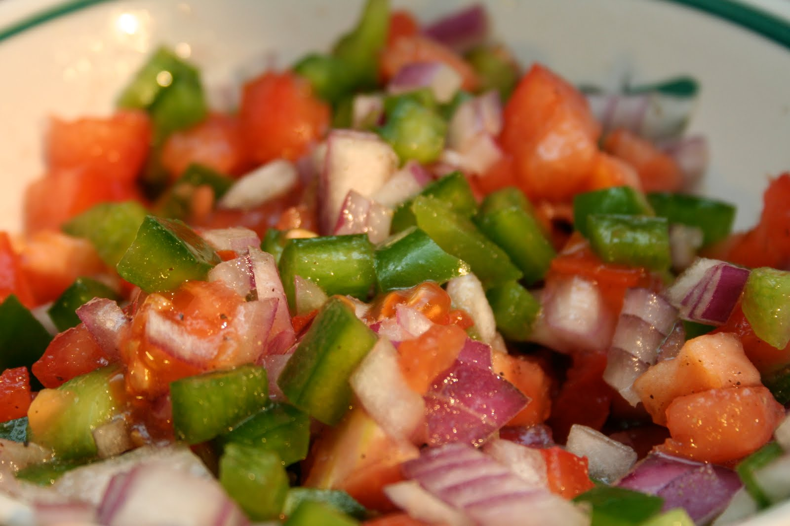 You top the dish with the salad of tomato, red onion, and green pepper. Bright, fresh, and crunchy, it breaks up the richness of the meat, eggs and potatoes. The dressing is equal parts vinegar and oil, plus generous salt.