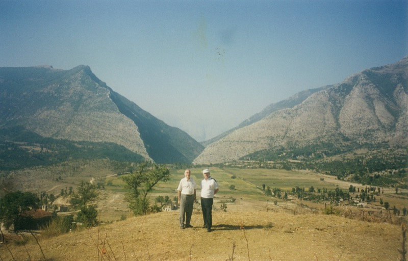 Two brothers visiting the place where they began their escape from Albania in their youth.