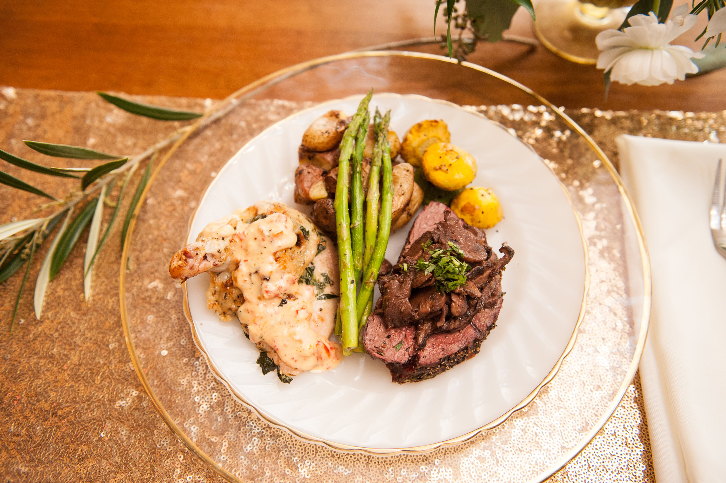 Beef tenderloin, sautéed asparagus, roasted chicken with garlic cream sauce, roasted squash