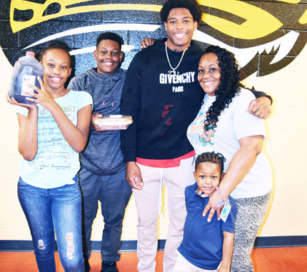 Jacksonville Jaguar Cornerback, Jalen Ramsey snaps a picture with a local Springfield family who he gave a Thanksgiving day meal.