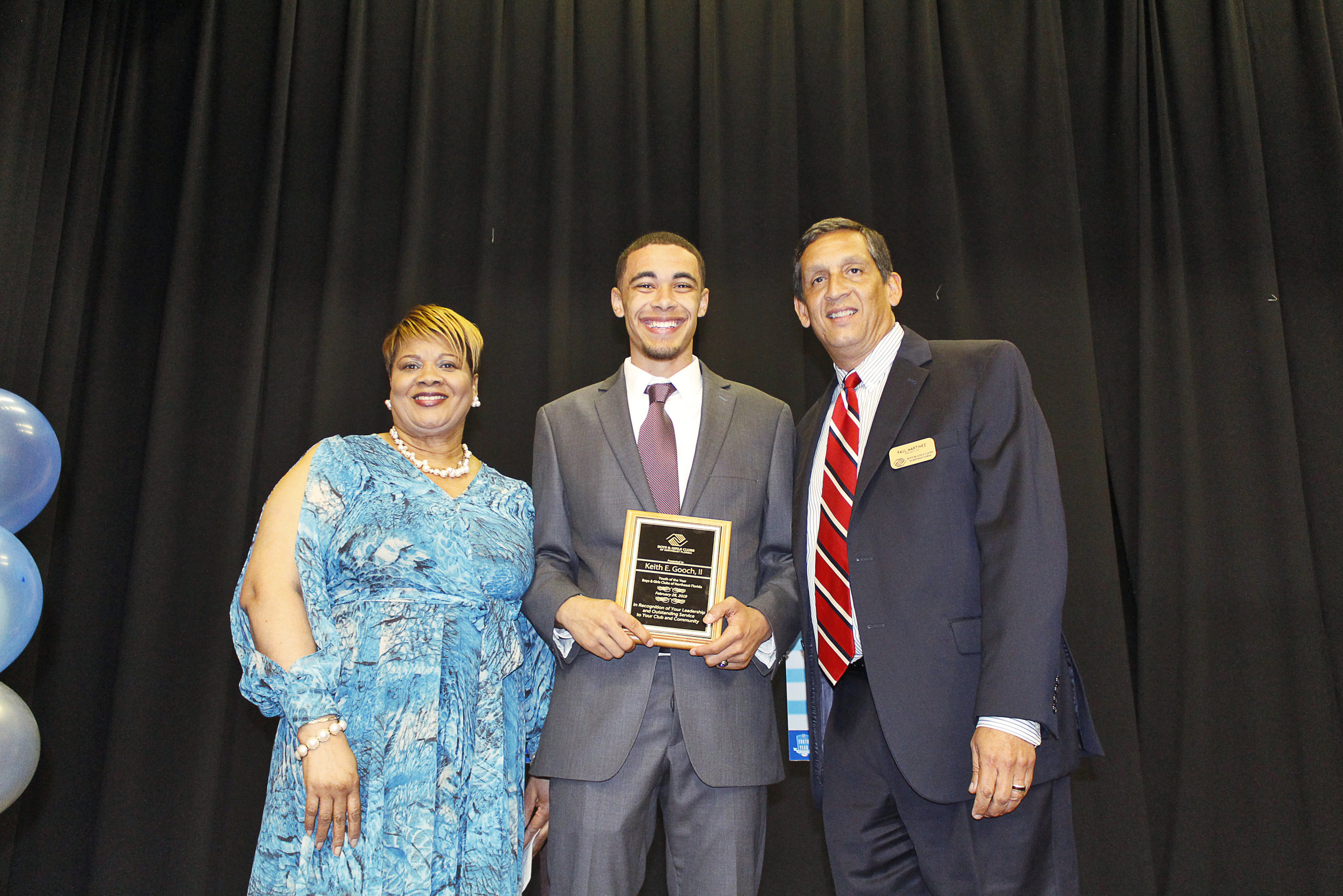 Executive Area Director, Yvonne Thompson, Keith Gooch, II, Boys & Girls Clubs of Northeast Florida's Youth of The Year and Paul Martinez, President and CEO of Boys & Girls Clubs of Northeast Florida.