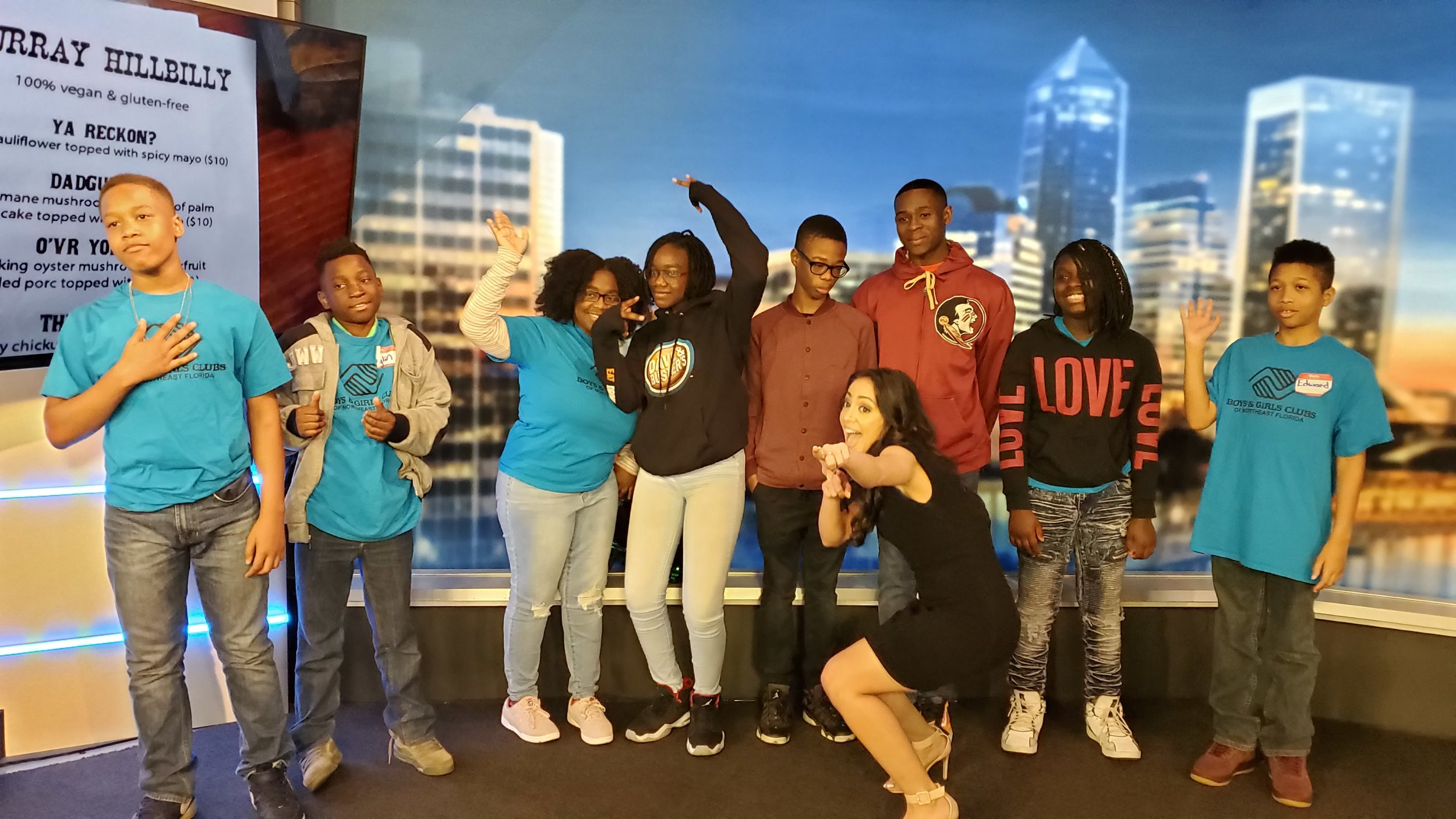 Bridge Connection One students strike a pose with First Coast Living's host, Haddie Djemal