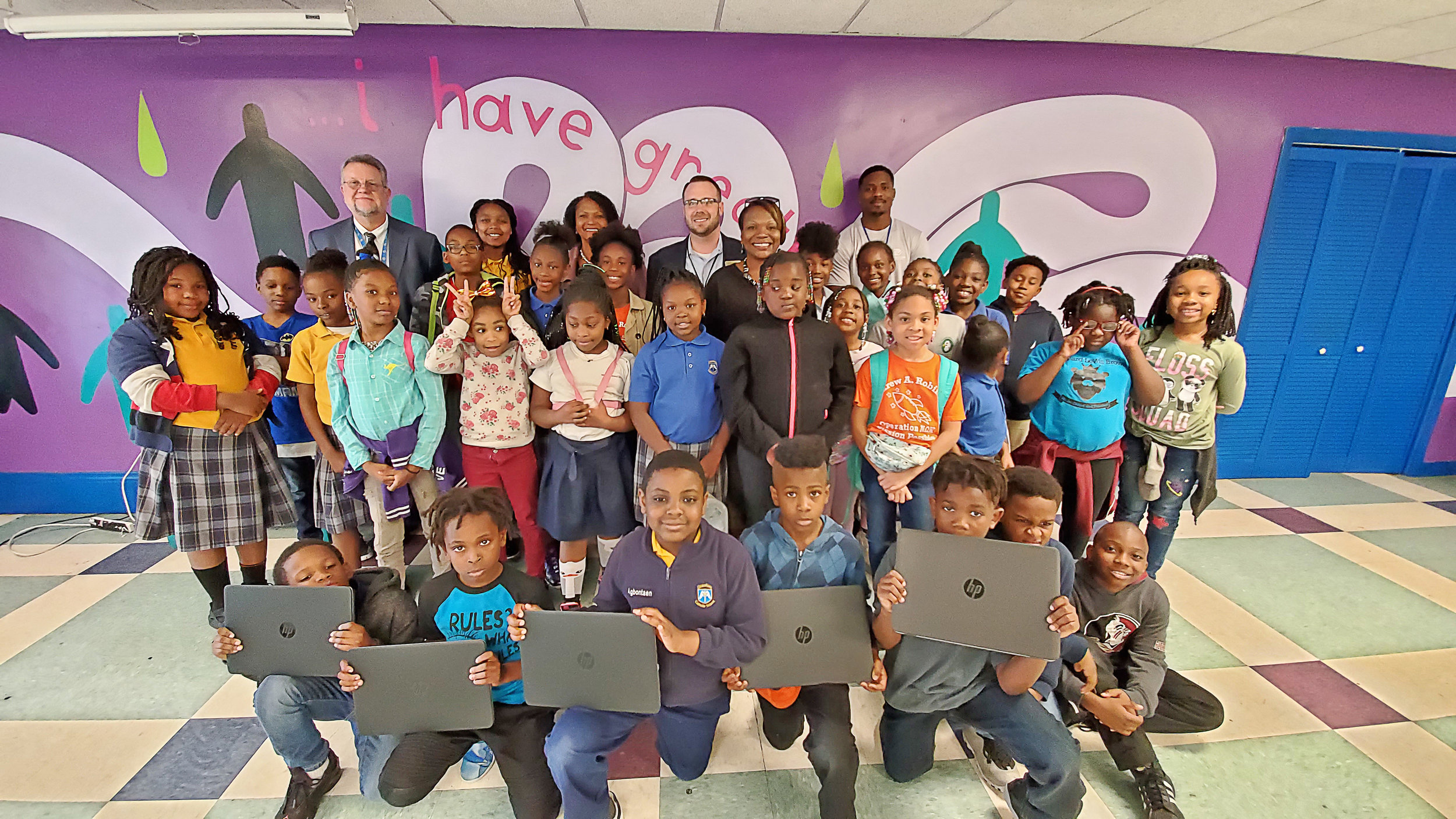 Bridge Boys & Girls Club - The Learning Center members with some of their new laptops.