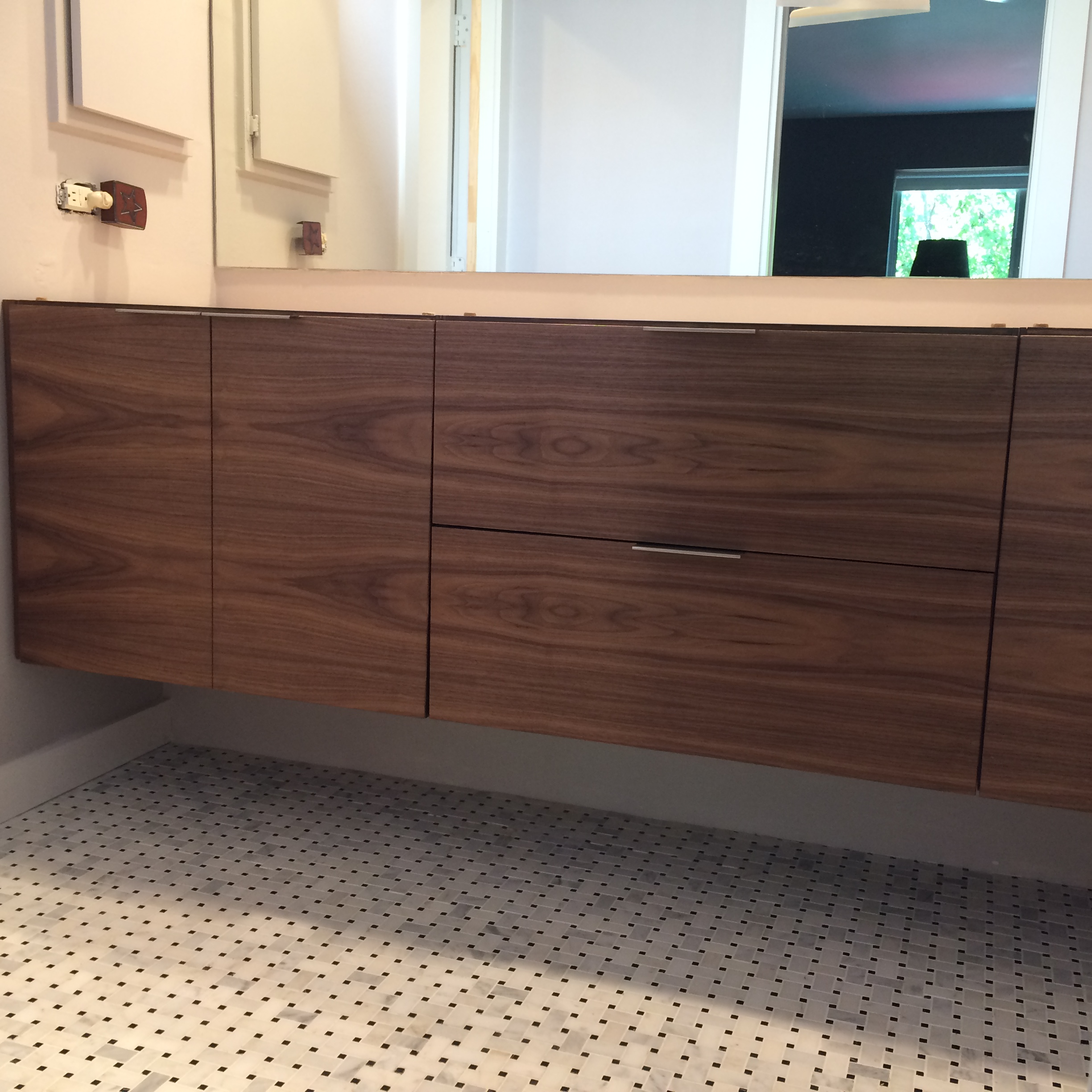Walnut floating vanity with horizontal grain