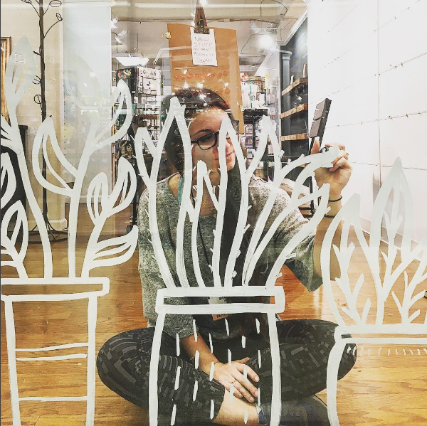 Our window design incorporated hand drawn plant figurines.