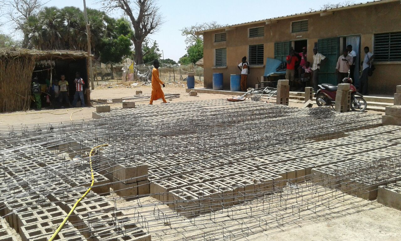 Building blocks and materials staging at Lamarame Primary School. See the current, makeshift classroom on the left.