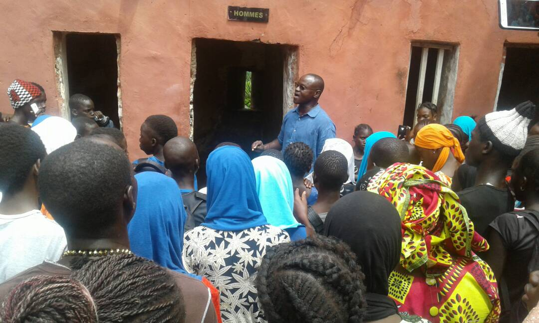 Tour guide at Goree Island sharing the history and significance of the site.