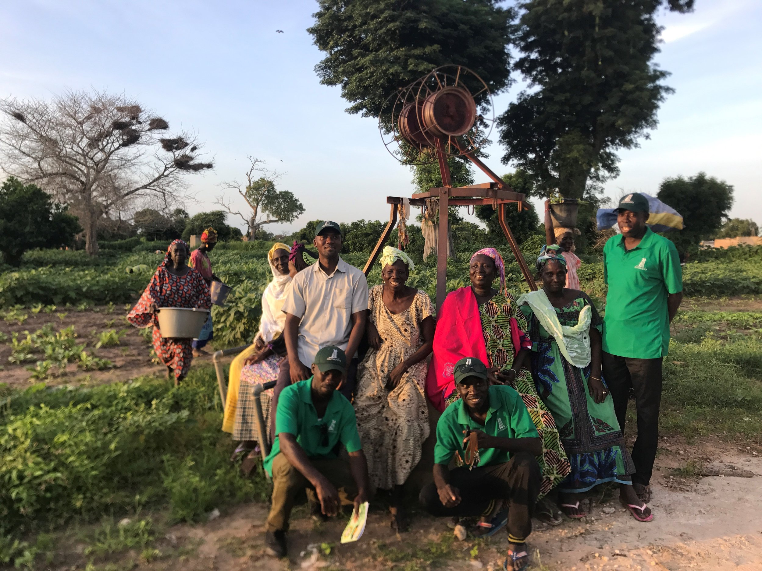 Andando staff hanging out with the women at Kouthieye Garden.