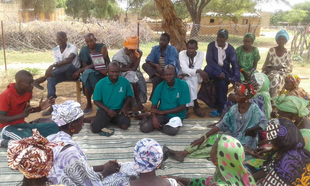 Officially introducing Sall as Garden Manager to the women and community representatives of Mbantou Croissement.