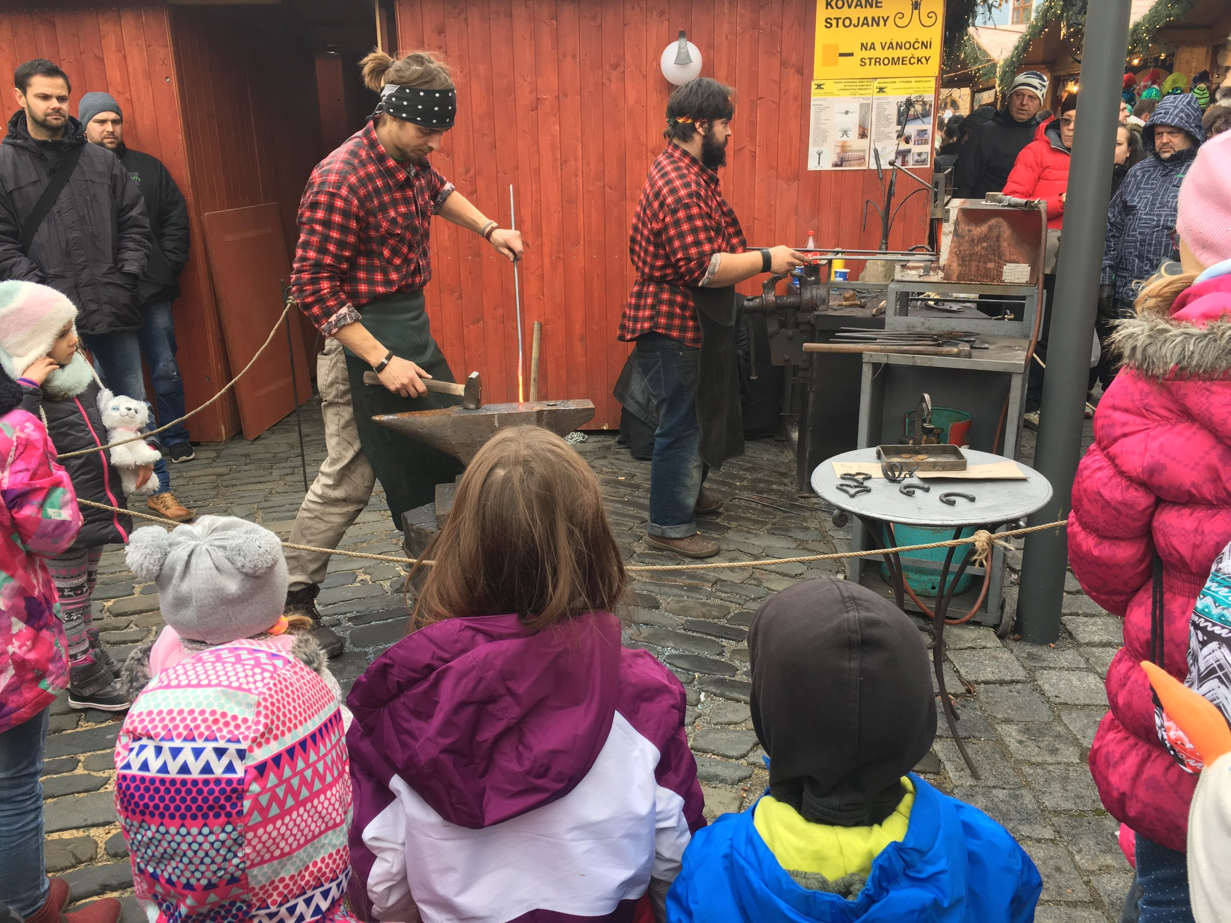 Watching a metal bending demonstration at the Christmas market.
