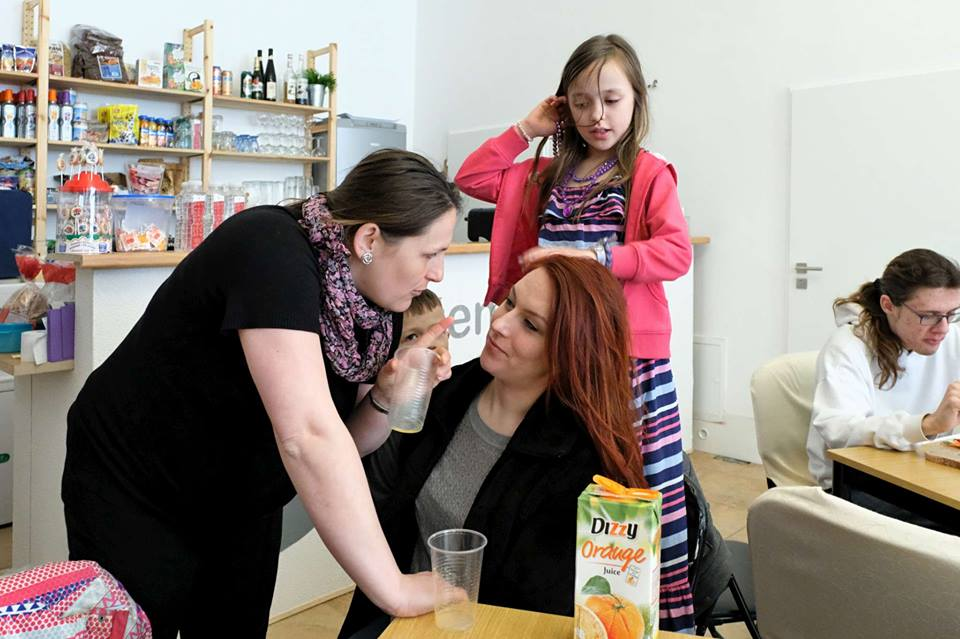 Lisa and Eva talking about babies, while Addey braids her hair.