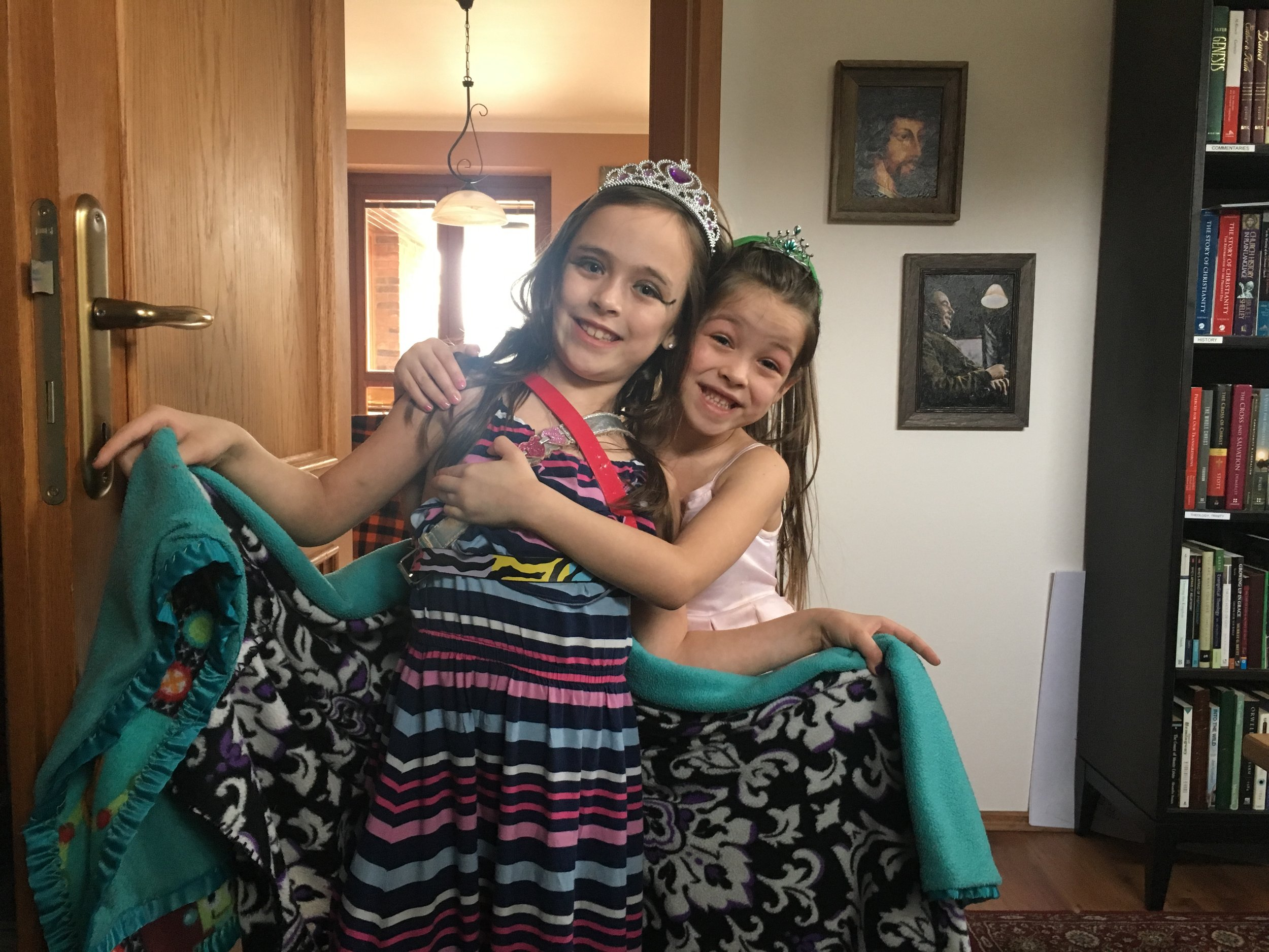 Addey and Nora dressing up as princesses for a special event at their school.