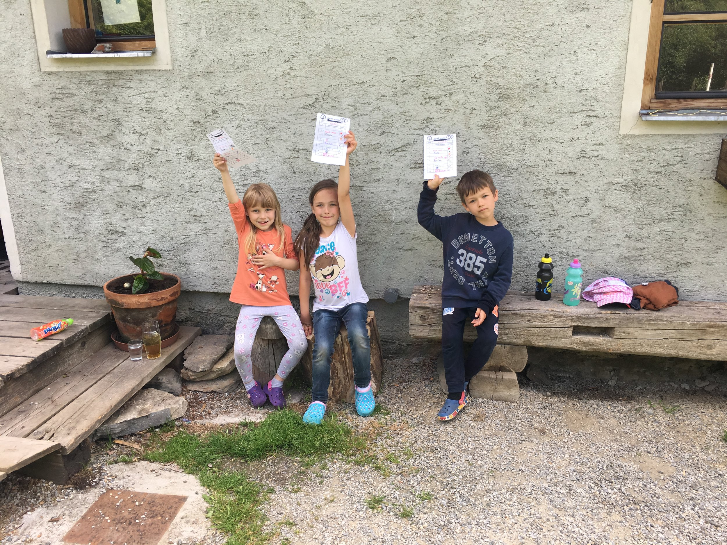 Metro kids showing off their scavenger hunt papers.