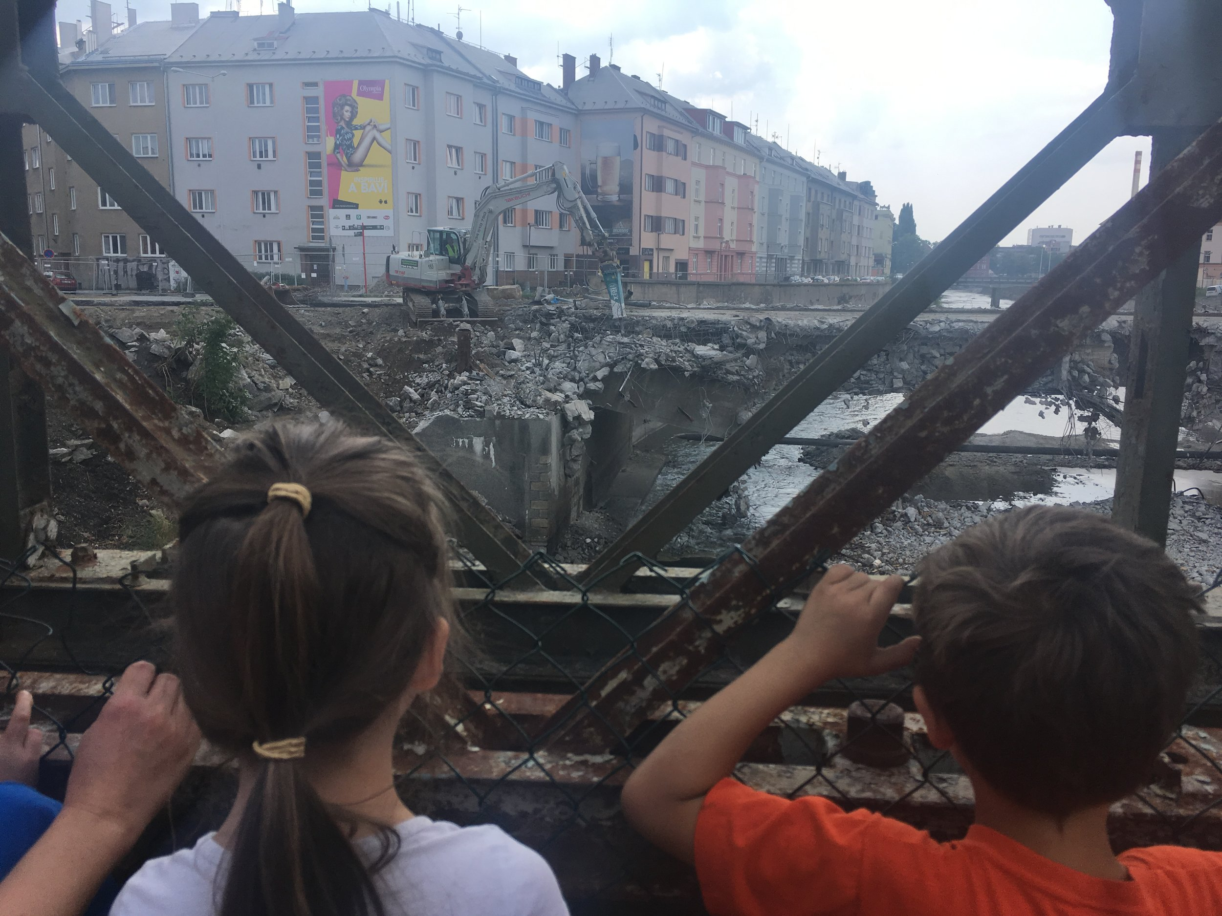 Watching the main bridge that connects our part of town to the city center get demolished. We've been told it won't be back up until sometime in May or June.