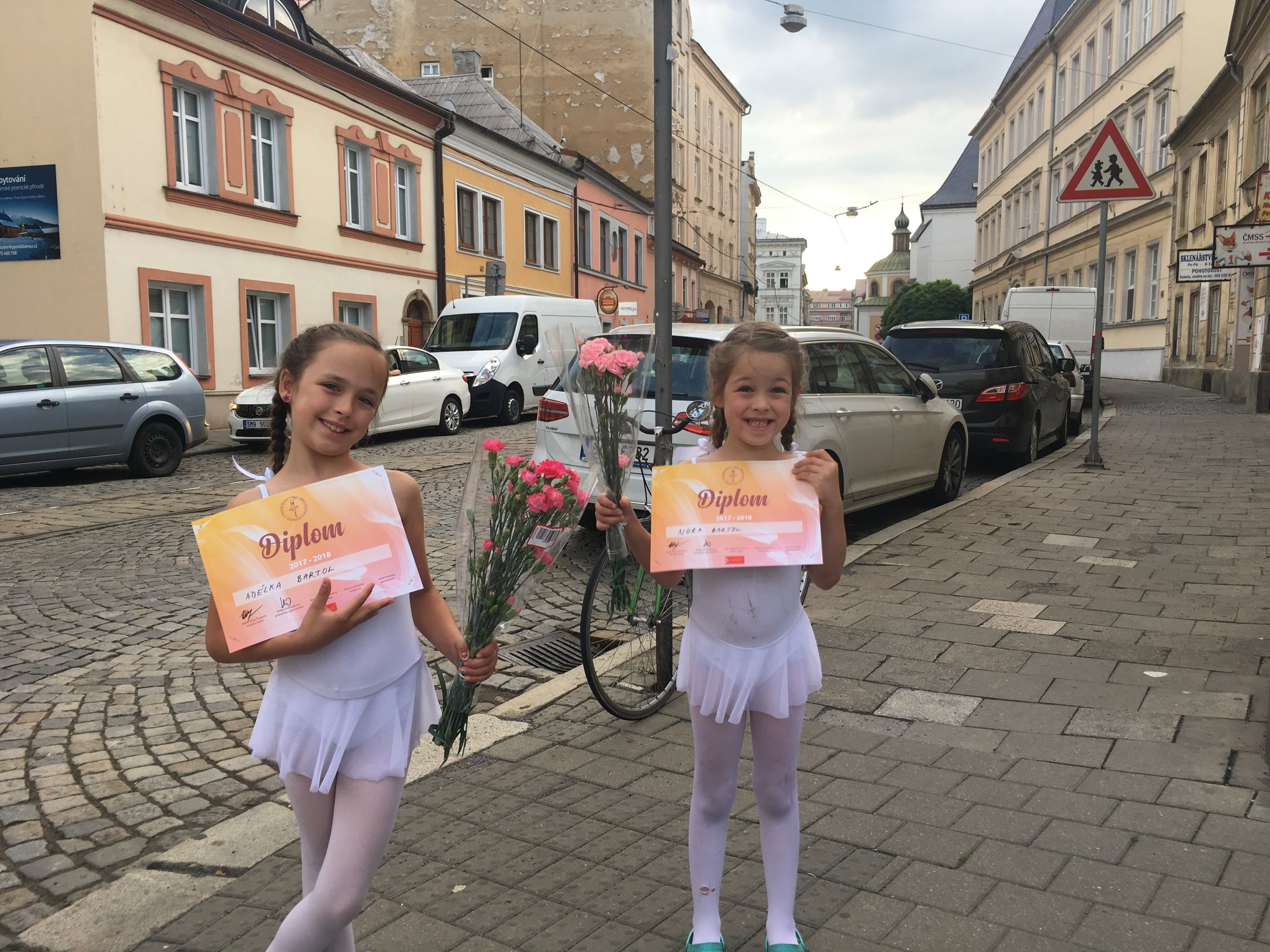 The girls received their diploma for the year of ballet.