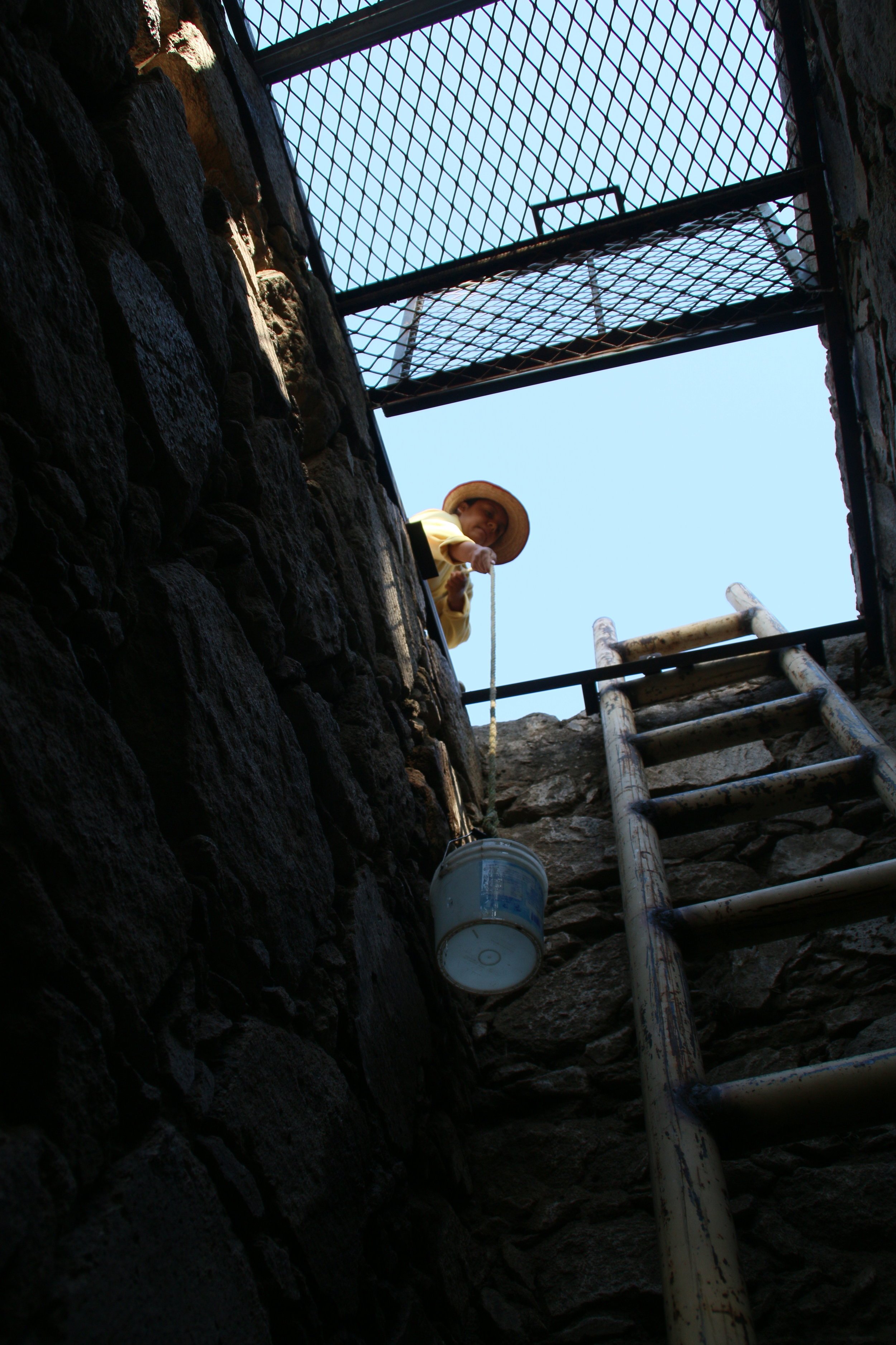 Members of the community previously had to extract water from the well using buckets tired to ropes - a dangerous process.