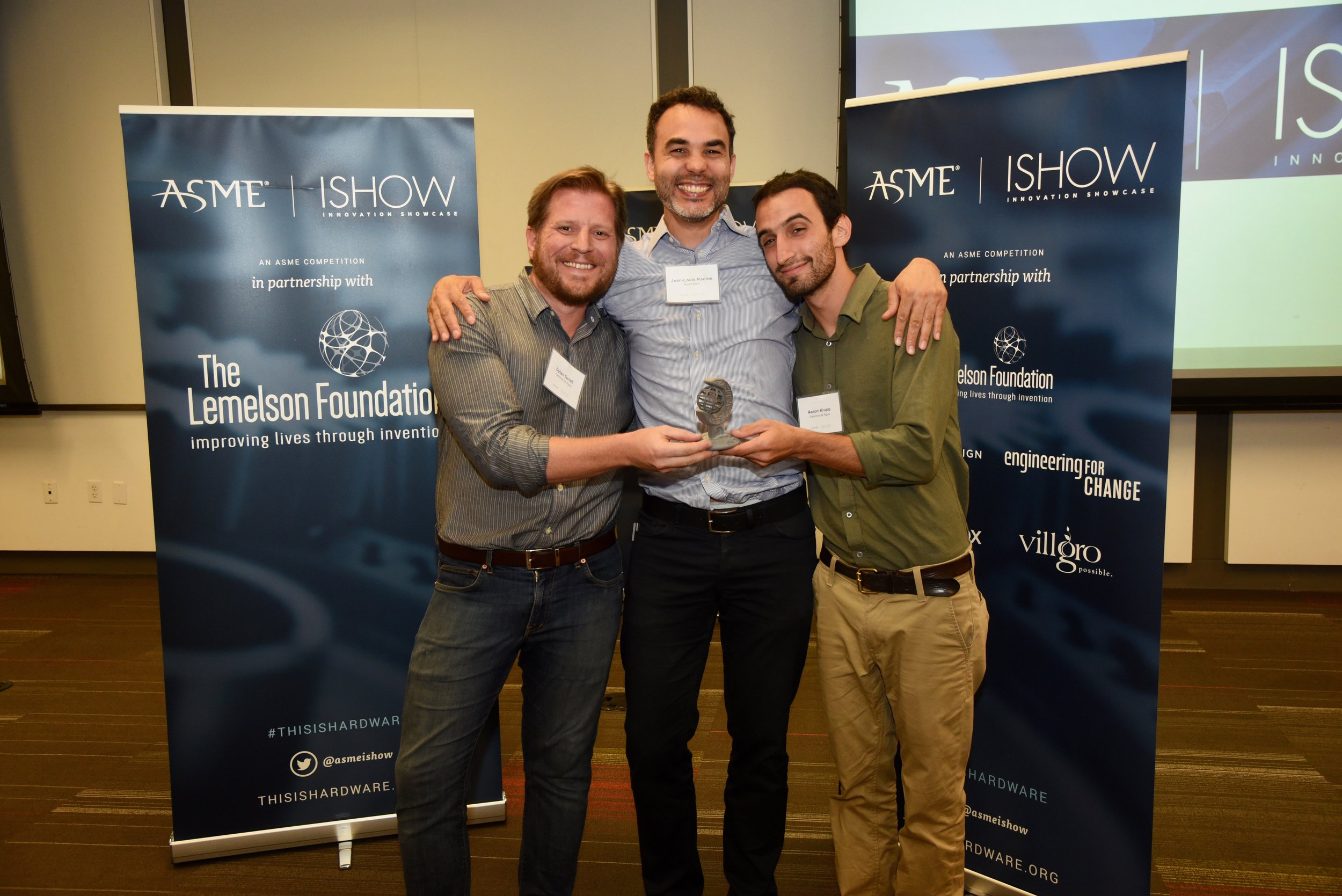 Aaron and Dylan receiving the Innovation Showcase Award from ASME ISHOW Judge Jean-Louis Racine