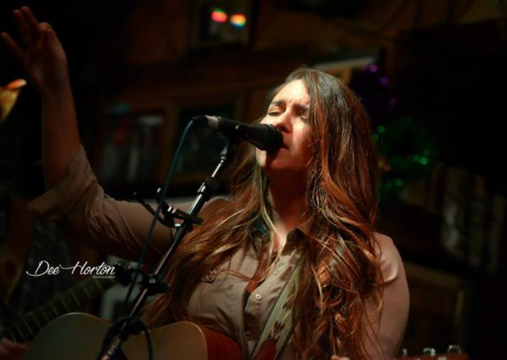 """CHRISTINA CHRISTIAN  PERDIDO KEY, FL  Born and raised in South Alabama, Americana/Country Singer-Songwriter, Christina Christian is in it for the long haul. For the past 5 years, Christina has traveled the Southeast, mainly Alabama, Mississippi, Tennessee, Georgia, and Florida to perform her music. The 22 year old currently lives in Perdido Key, Florida entertaining her home base along the the Gulf Coast.  Christina Christian got her foot in the door with music at young age, 8 years old to be exact. Her Father was a classic rock kind of guy, who always played guitar, and her Mother listened to Country. Christian was influenced tremendously by all sorts of music, which led to being creative with words and the first three chords on her decorated Johnson guitar. In Middle school, she wrote poetry, and kept writing all the way into high school until her independent studies class gave her the freedom to learn more about Songwriting. She picked up guitar at the age of 16, after taking a shot at her high school talent show her sophomore year.  Originally, Christina wanted the college life. She had the dream of becoming a Sports Medicine Trainer for Football (Roll Tide) But, there are some things you can't deny, and that was her love for music. So, taking a few steps forward, Christina ended up with 6 scholarships to pay her way through college at Troy University. She decided a Music Industry degree was the path for her. Christina's first day in college was a day that changed her life forever. Her professor was the real deal, who worked with Michael Jackson back in the day, MICHAEL JACKSON. She will never forget the first words that came out of Mr. Smith's mouth. """"You do not need a degree to be in the music industry."""" Christina took those words to heart and within the year, she withdrew from college to work in the real world.  Since moving back from college at the age of 19, Christina has been a waitress, a pizza slinger, a zip-line guide, and first and foremost, a musician"""