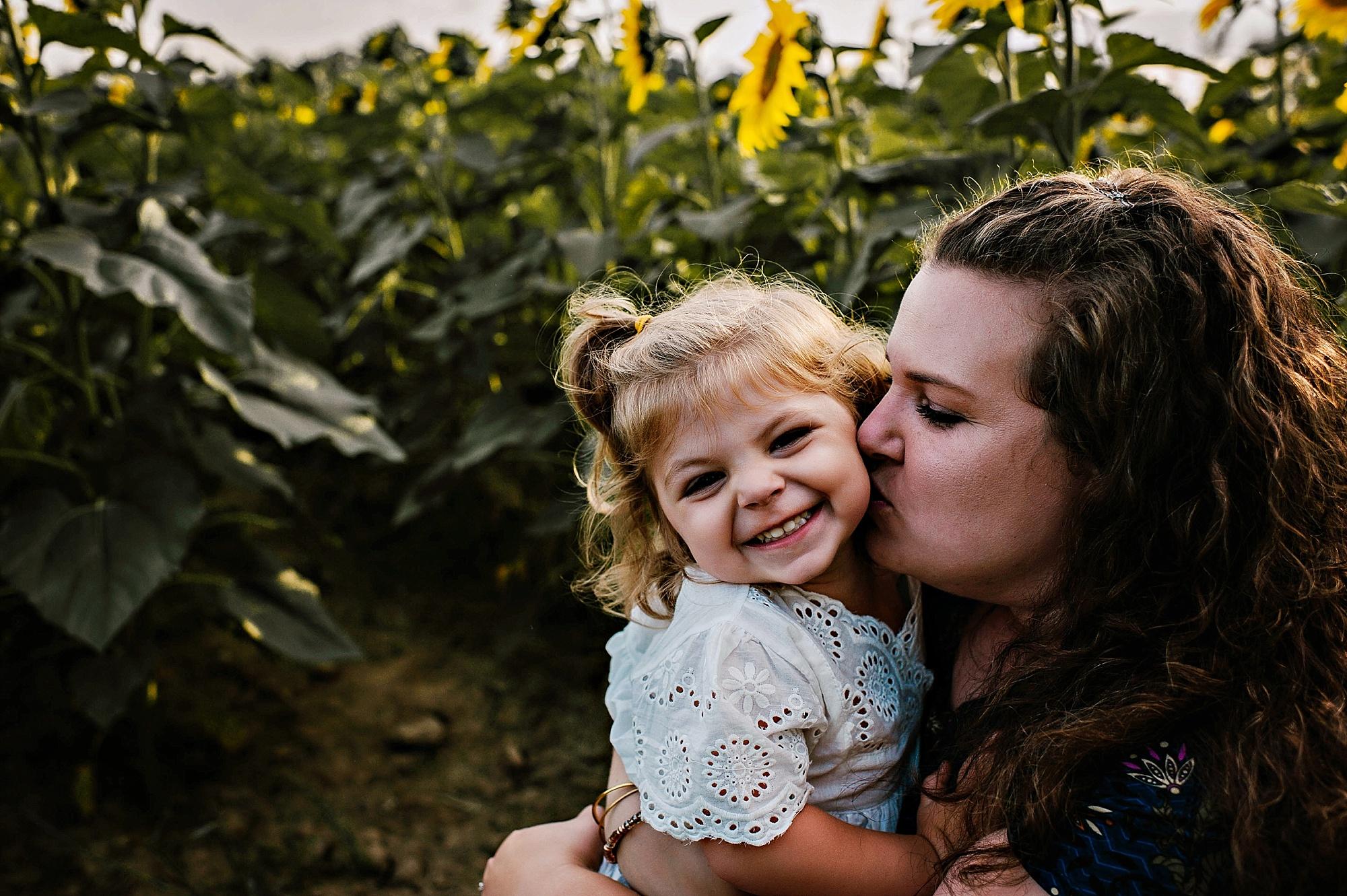 Rutherford-family-cleveland-photographer-lauren-grayson-sunflower-field-session_0017.jpg