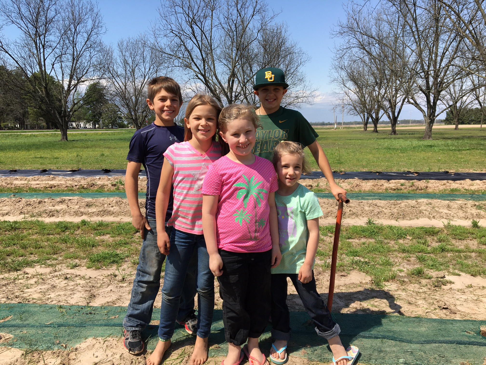 cousins planting the family garden