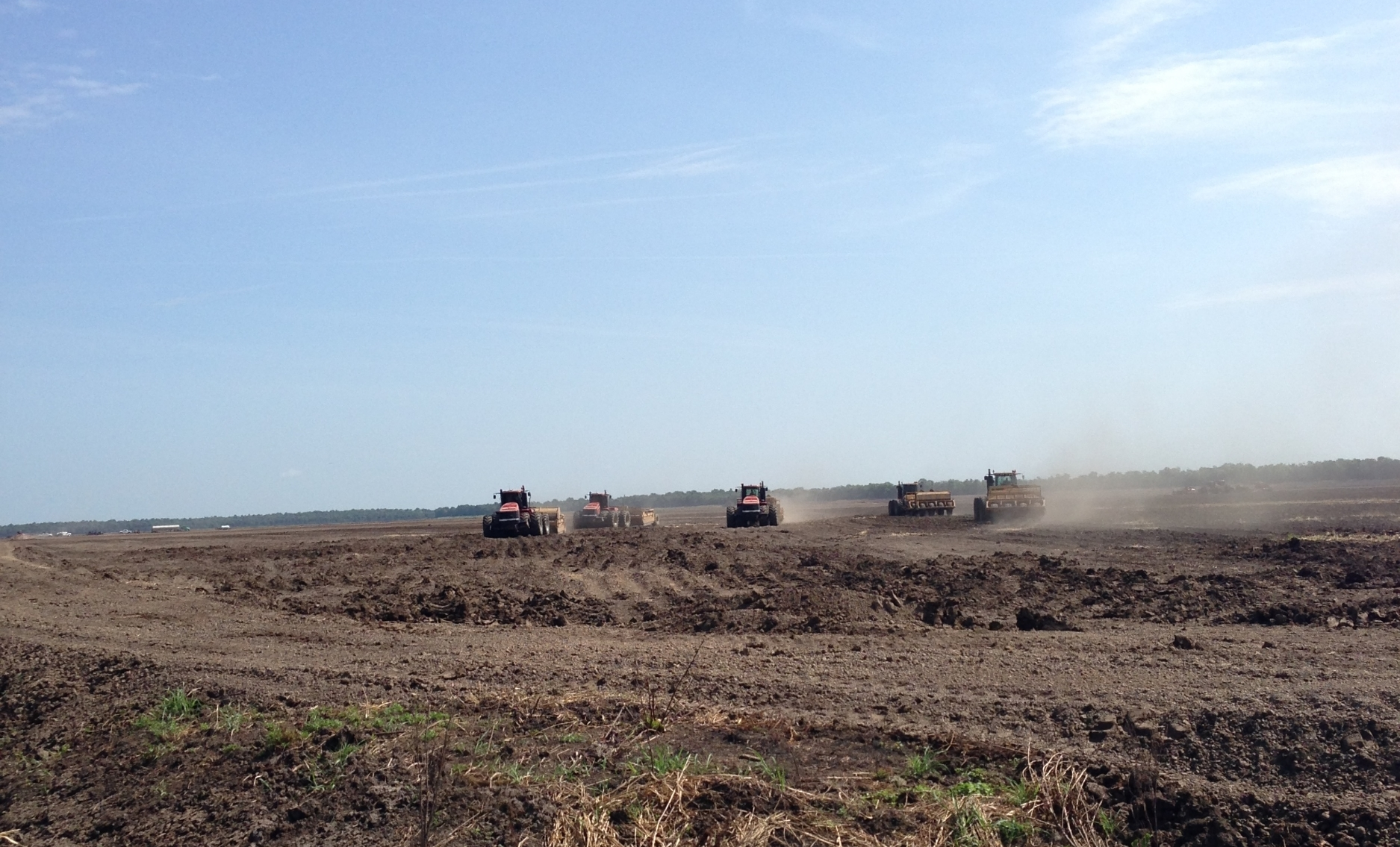 dirt moving equipment following GPS guided software to level one of our new fields to zero grade