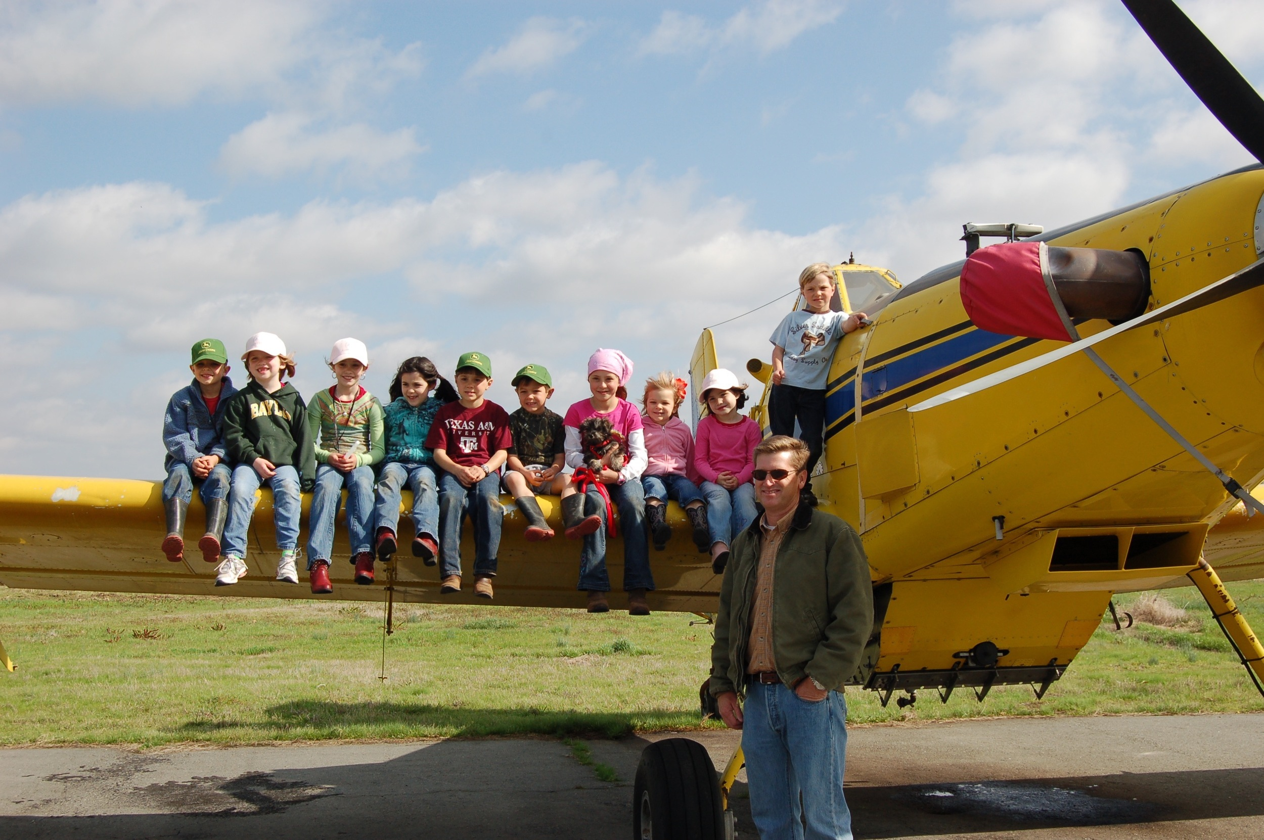 friends learning about ag airplanes at the rural airport