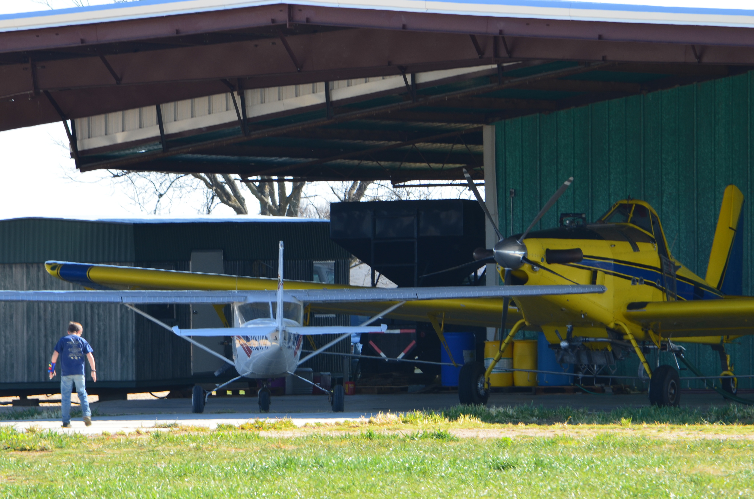 yellow ag plane and white passenger plane