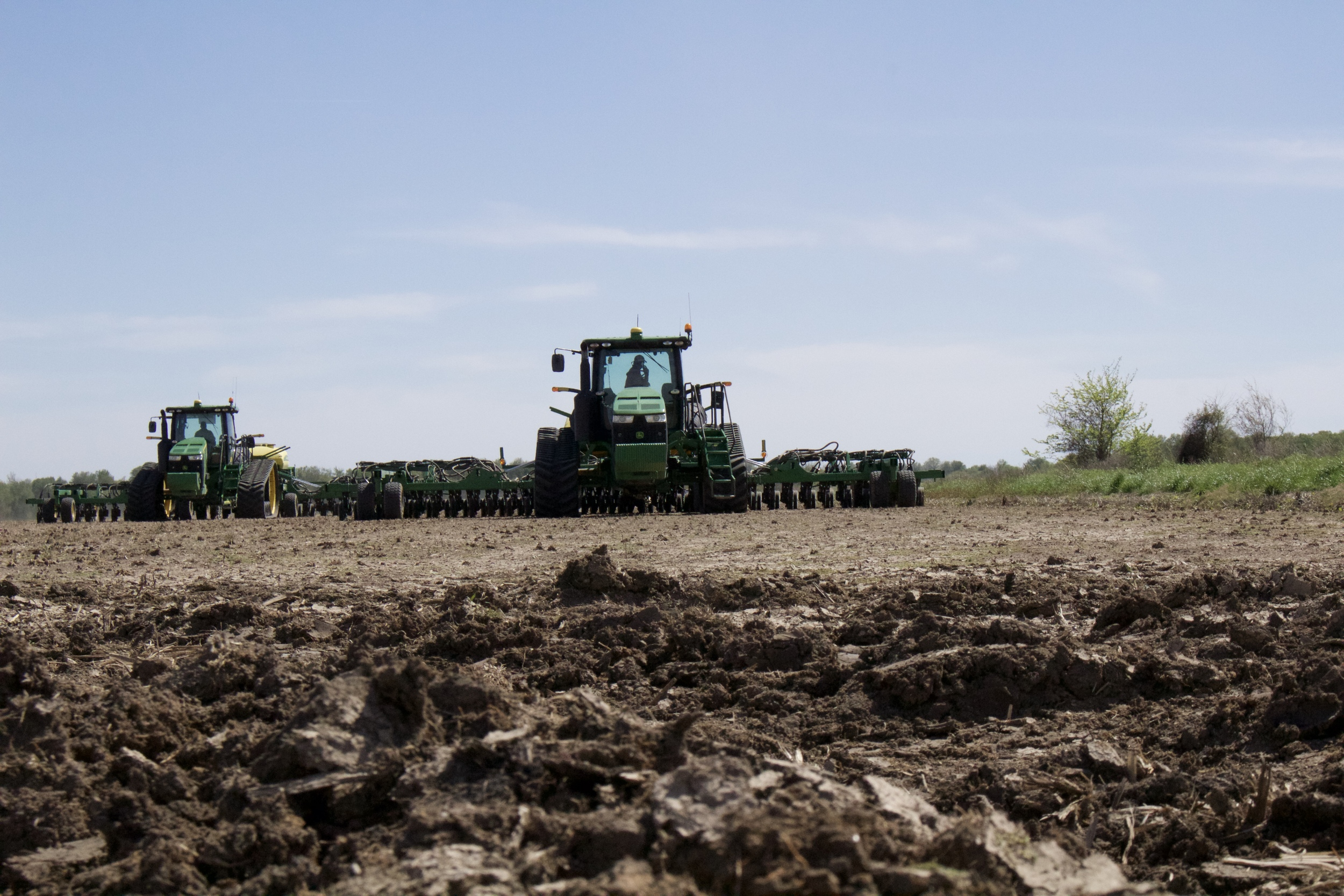 Tractors planting rice                                                                                                                                                                  Photo Credit:  Morgan Baugh