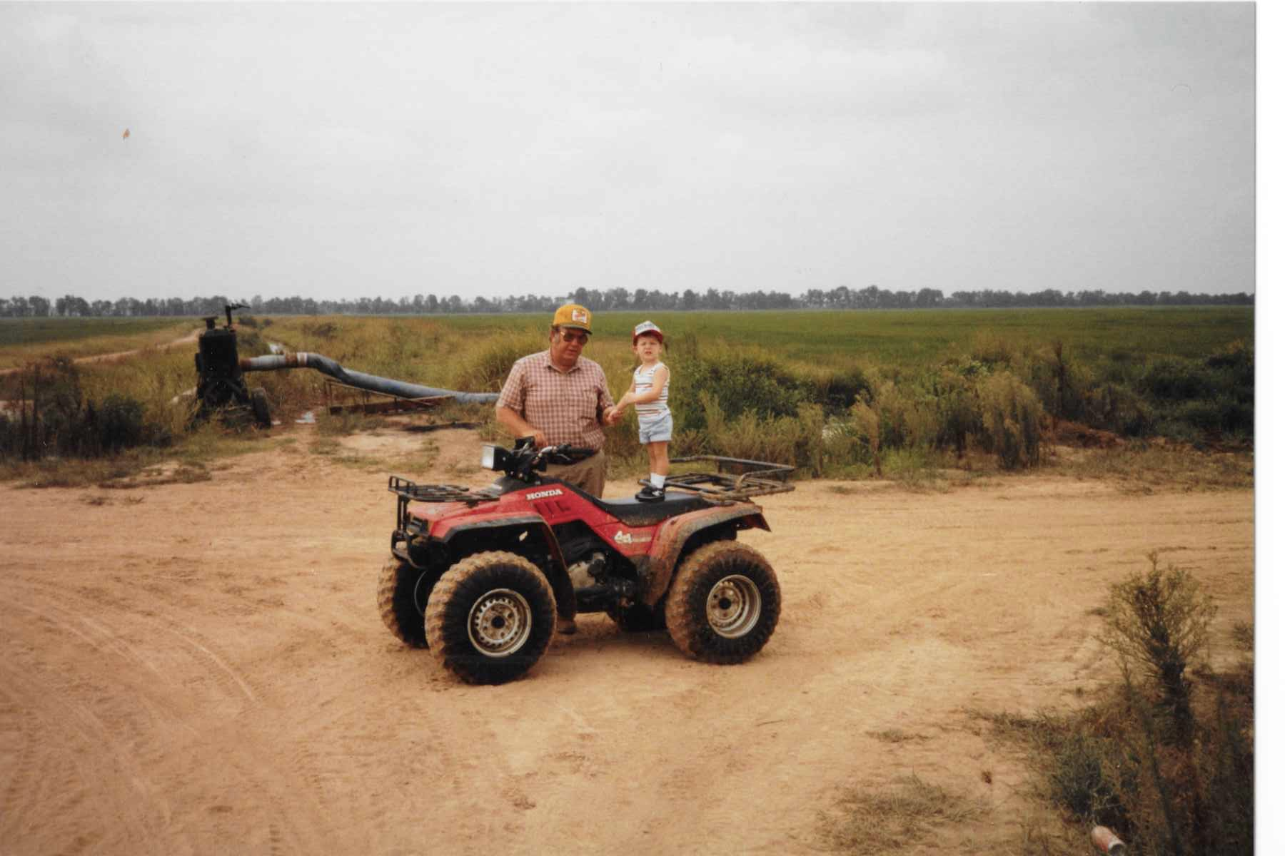 My dad and nephew in front of a well that supplies the water to surrounding rice fields