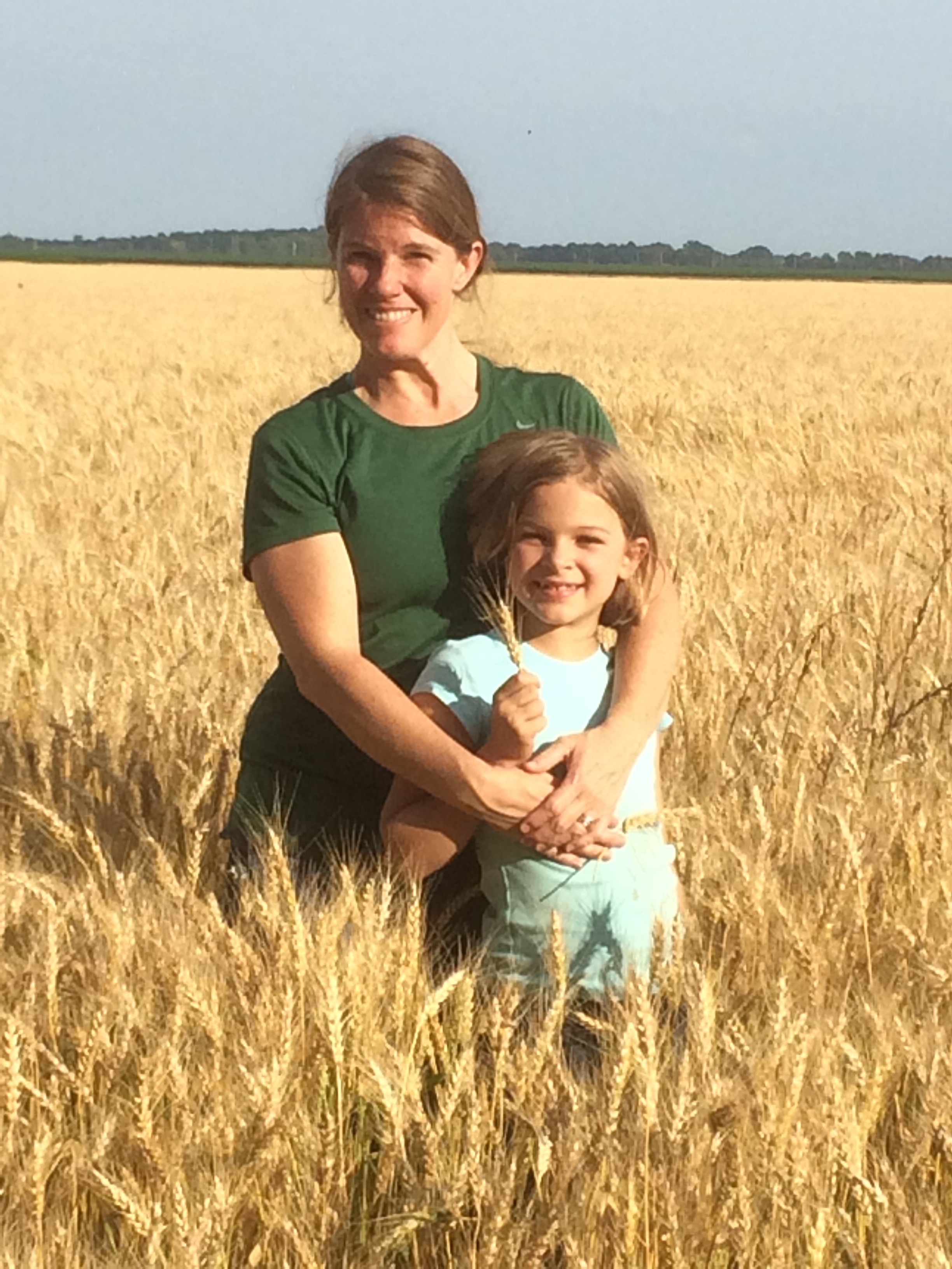 my daughter and me in a wheat field ready for harvest
