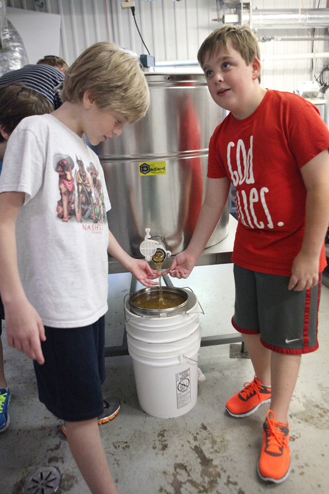 And, that's basically it! From there, the honey is ready to enjoy. It can be poured into smaller containers and will never spoil. It will eventually crystallize, but can be heated gently to return it to its liquid state. We couldn't wait and sampled it every chance we got!