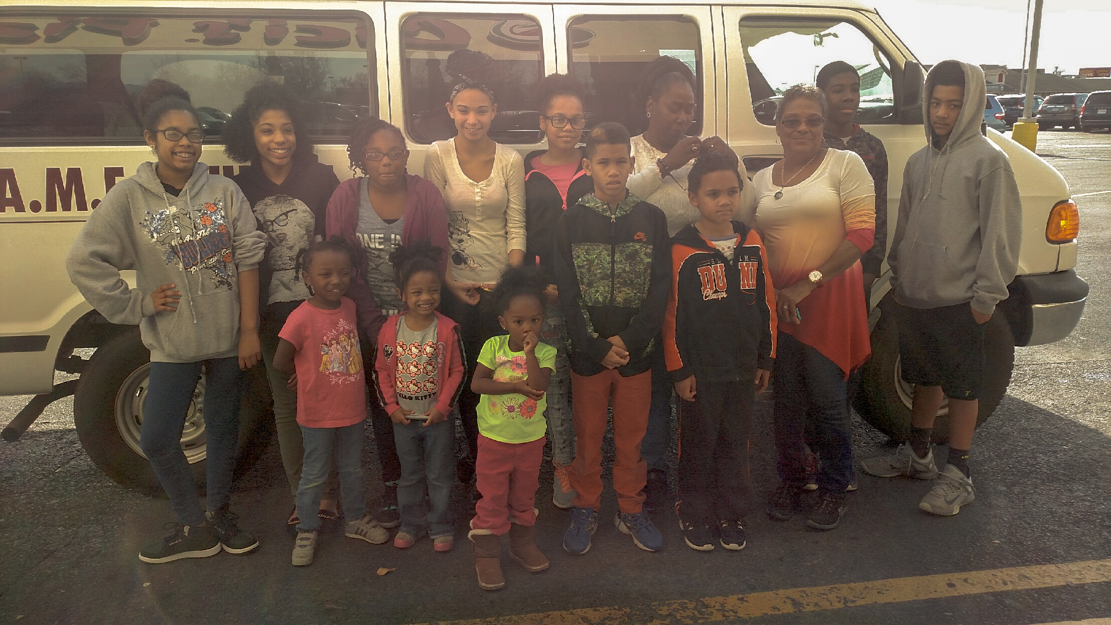 The Children's Ministry in front of an AME van.