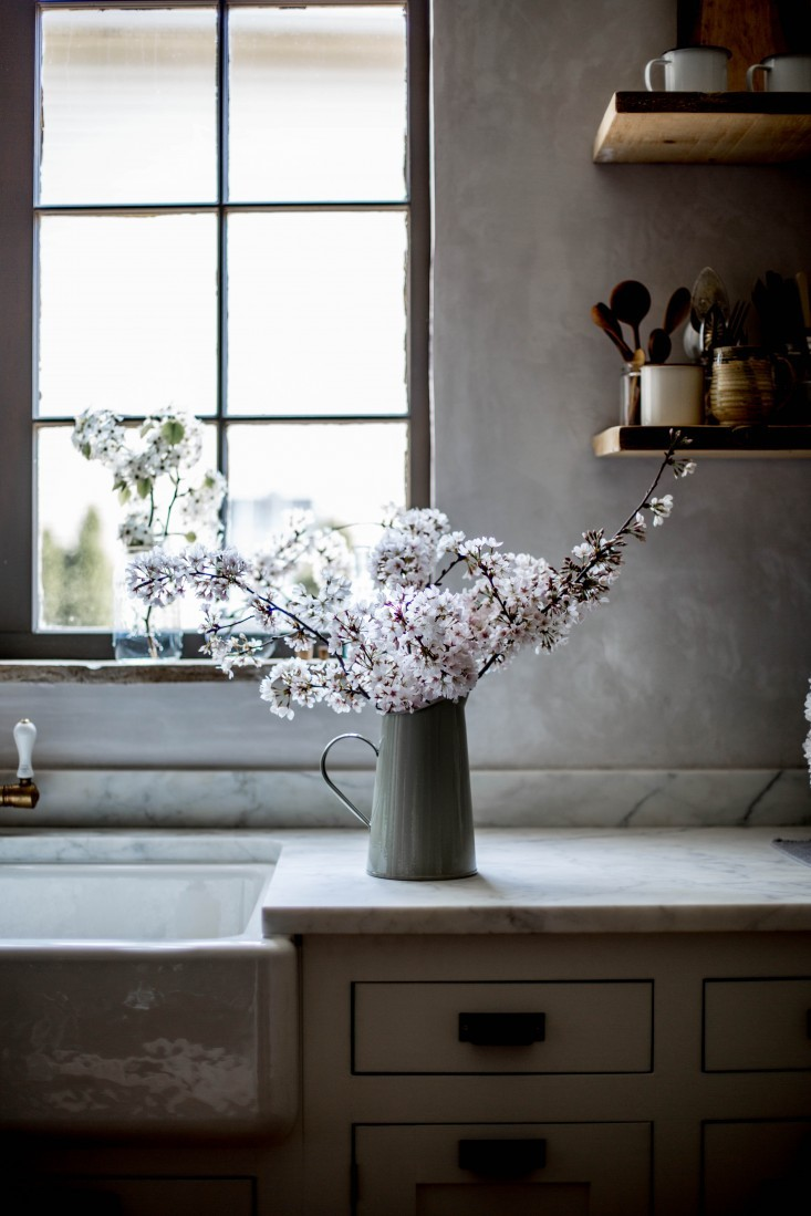 """White Calacatta Velluto marble countertops are not for Type A's, warns Beth. """"With marble, you have to know what you're in for… You have to decide that you want the story of your cooking etched in your counter."""""""