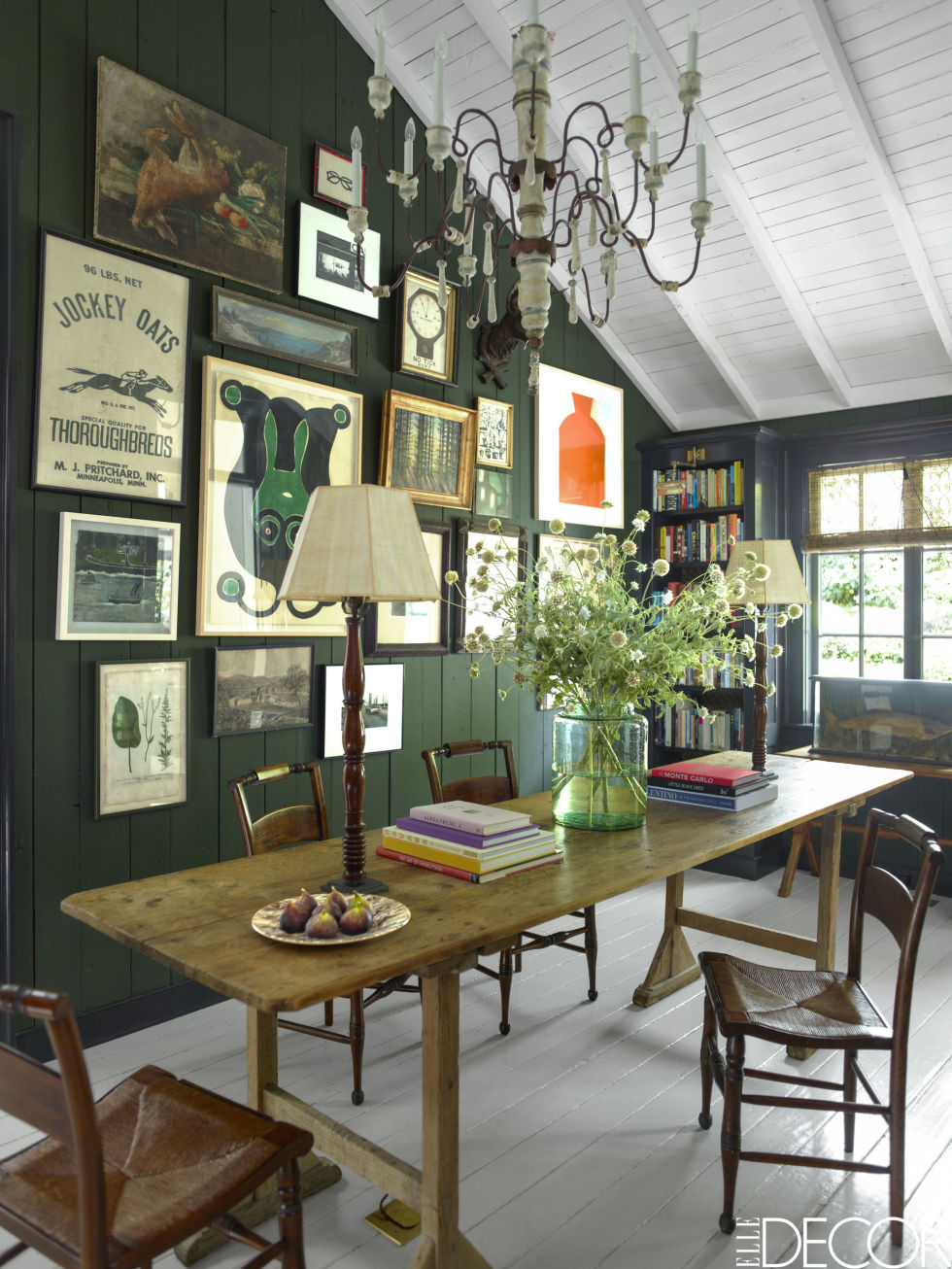 Emery & Cie' s 'Vermoulu 6' deep hunter green provides the perfect backdrop for the couple's collection of art.