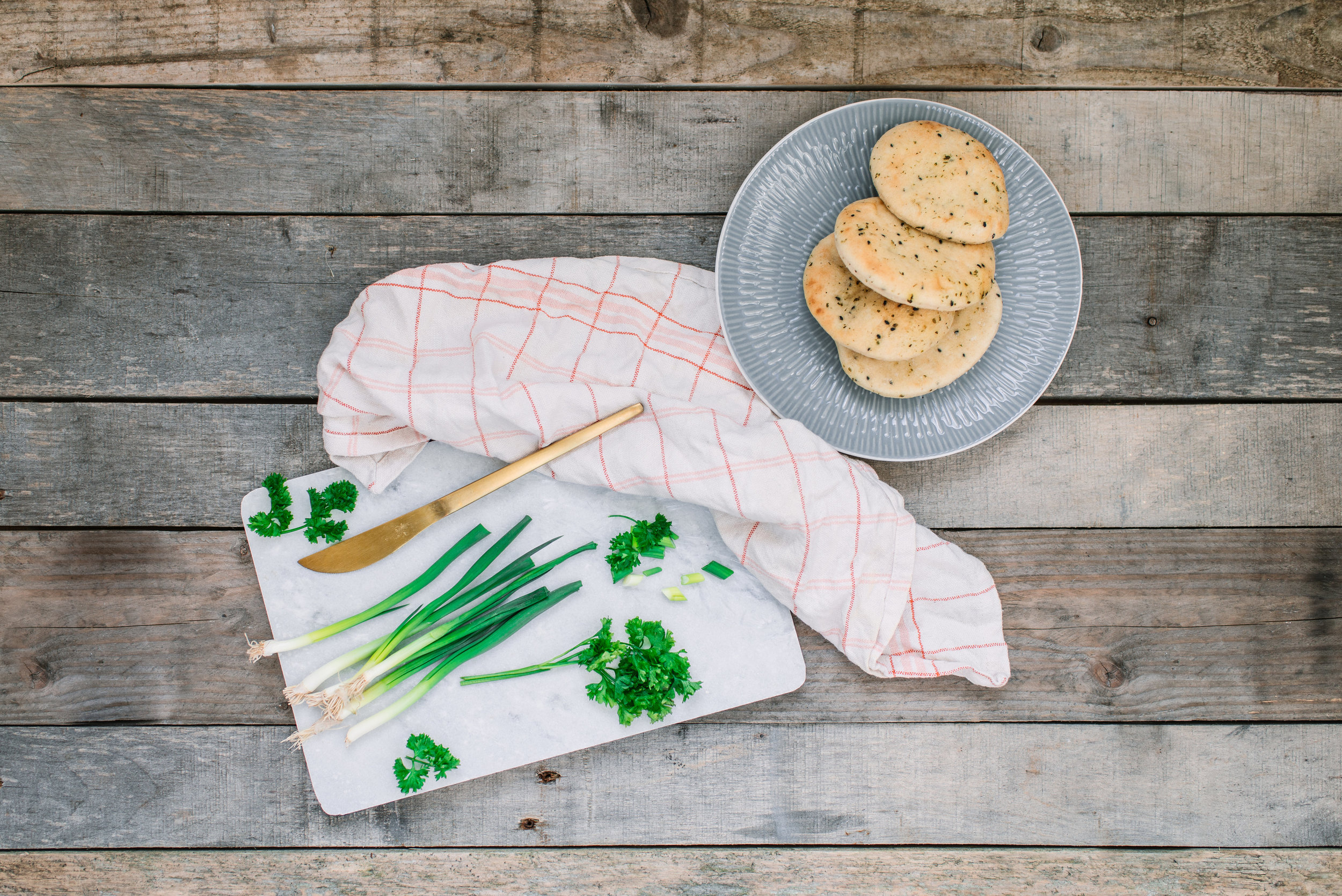Paper_and_Moon_Louise_Dockery_food_recipe_flatbread_naan_bread_spring_onions_marble_cutting_board_lunch.jpg