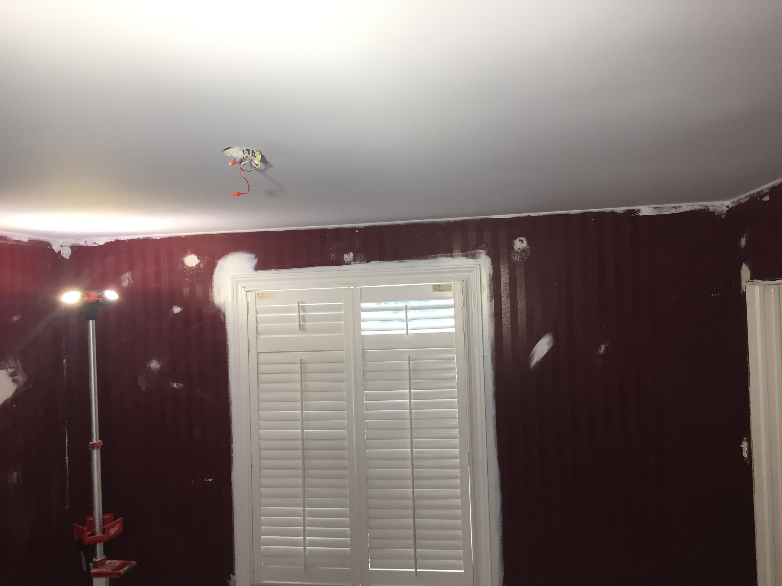 At this point the ceiling has been power sanded, has received 2 skim coats of drywall compound to ACHIEVE a smooth finish. A coat of primer is applied and we inspect every inch of the ceiling with a powerful spot light to find any imperfections.